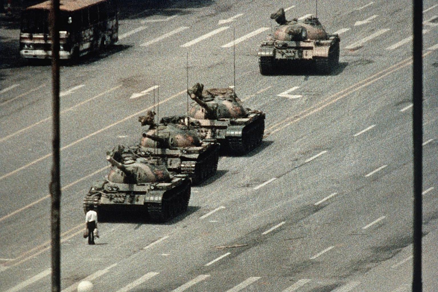 The iconic image of a lone unidentified man blocking a convoy of tanks during the Tiananmen Square protests in Beijing on June 5, 1989. American photojournalist Charlie Cole, who shot the image from the balcony of a hotel with a telephoto lens, has d