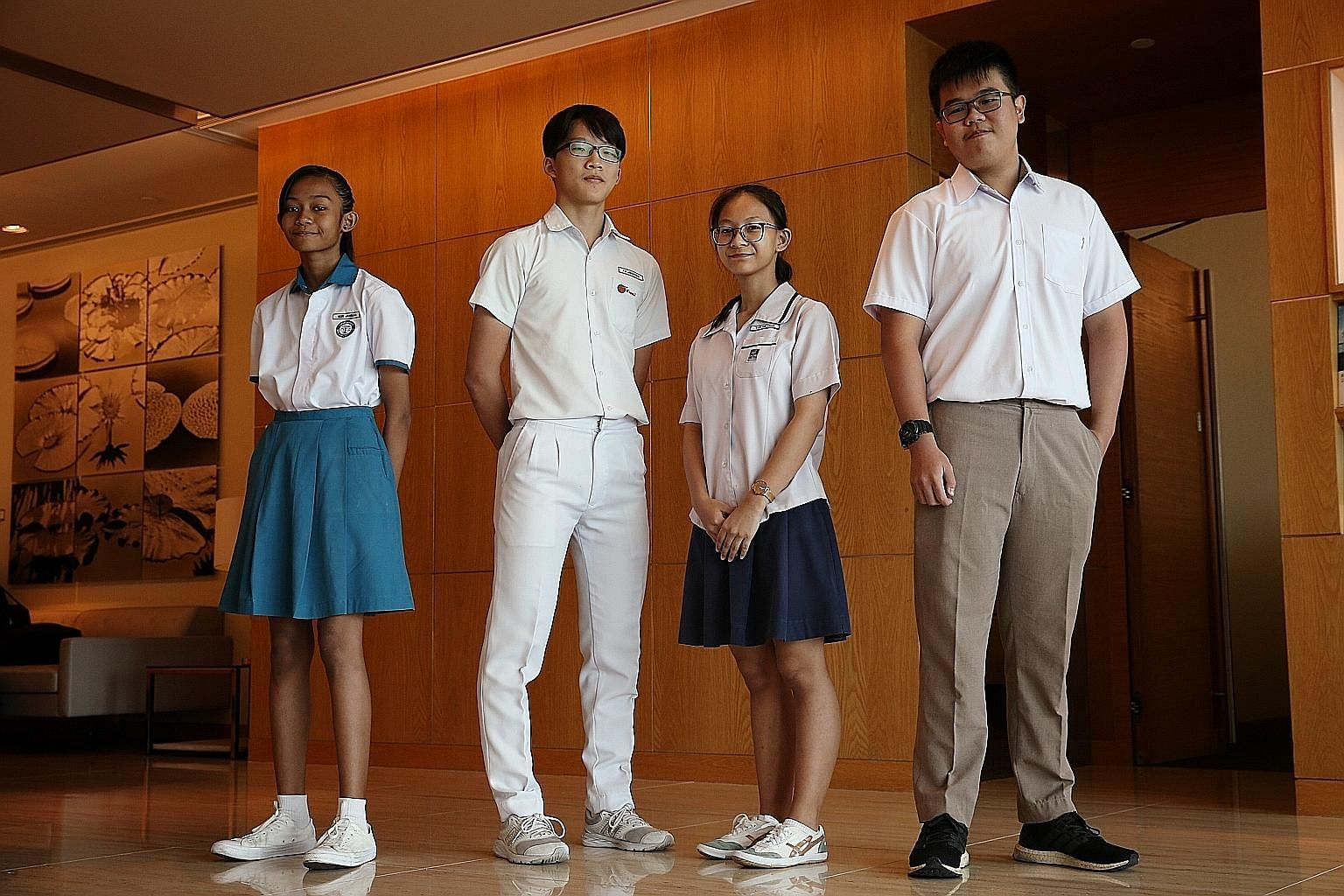 (From left) Nur Jannah Baizurah Abdullah, 12; Xu Jing Feng, 16; Tan Hui Xuan, 15; and Jacky Yeo, 18, are among the 30 beneficiaries of the school pocket money fund who received cash awards from Capital Group for doing well in their co-curricular activitie