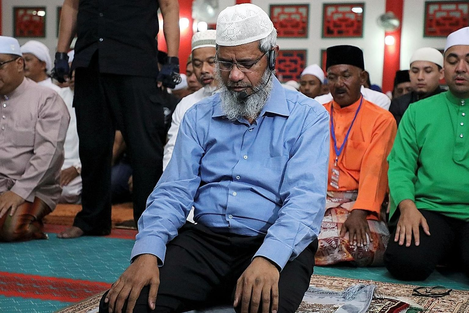 Indian Islamic preacher Zakir Naik praying at a mosque in Melaka, Malaysia, on Sept 7. The writer argues that though Dr Zakir is allowed to remain in Malaysia as he has political value, it is time for the government to look after the interests of Mal