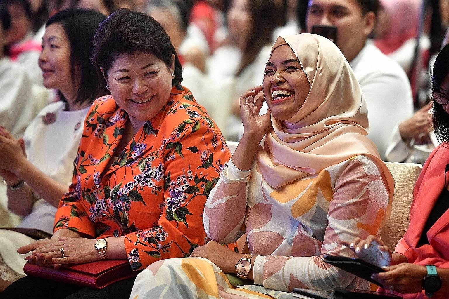Ms Nabillah Jalal and Ms Susan Chong, who were on the panel at the PAP Women's Wing annual conference yesterday, sharing a lighthearted moment as they were introduced before the discussion. PHOTO: CHONG JUN LIANG