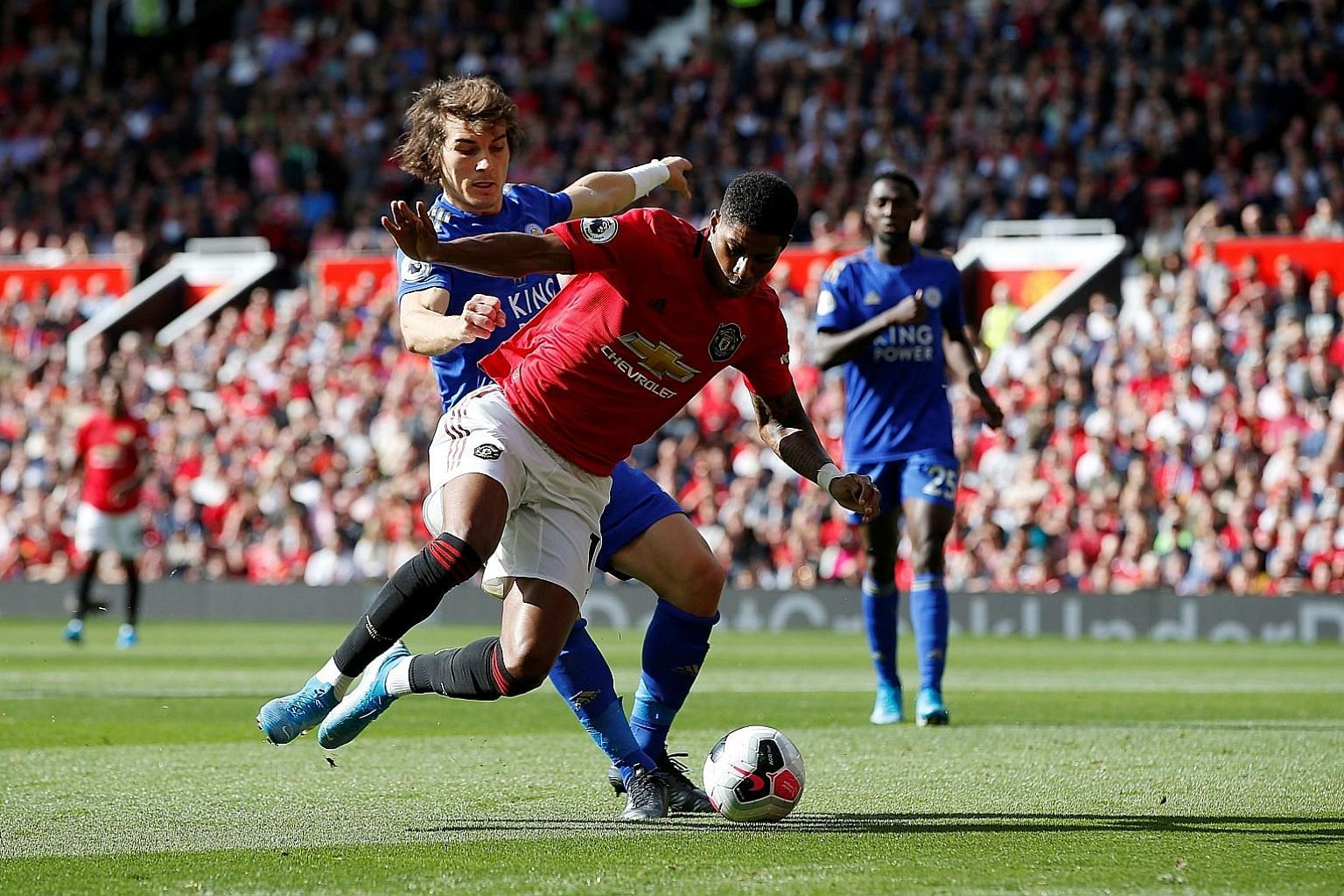 Manchester United's Marcus Rashford going to ground after a challenge by Leicester defender Caglar Soyuncu, earning a penalty from which the forward duly scored.