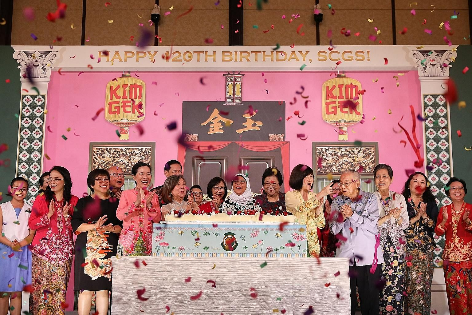 President Halimah Yacob (centre) celebrating Singapore Chinese Girls' School's 120th birthday last night, together with fellow SCGS alumni and other guests, including representatives of the SCGS board and staff. ST PHOTO: ONG WEE JIN