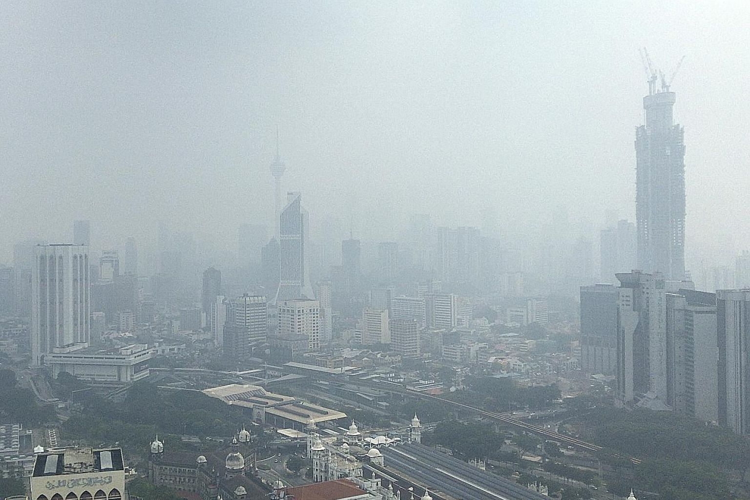 Kuala Lumpur shrouded in haze yesterday. Malaysia has lamented the lack of cooperation in solving the haze blanketing the region. PHOTO: ASSOCIATED PRESS