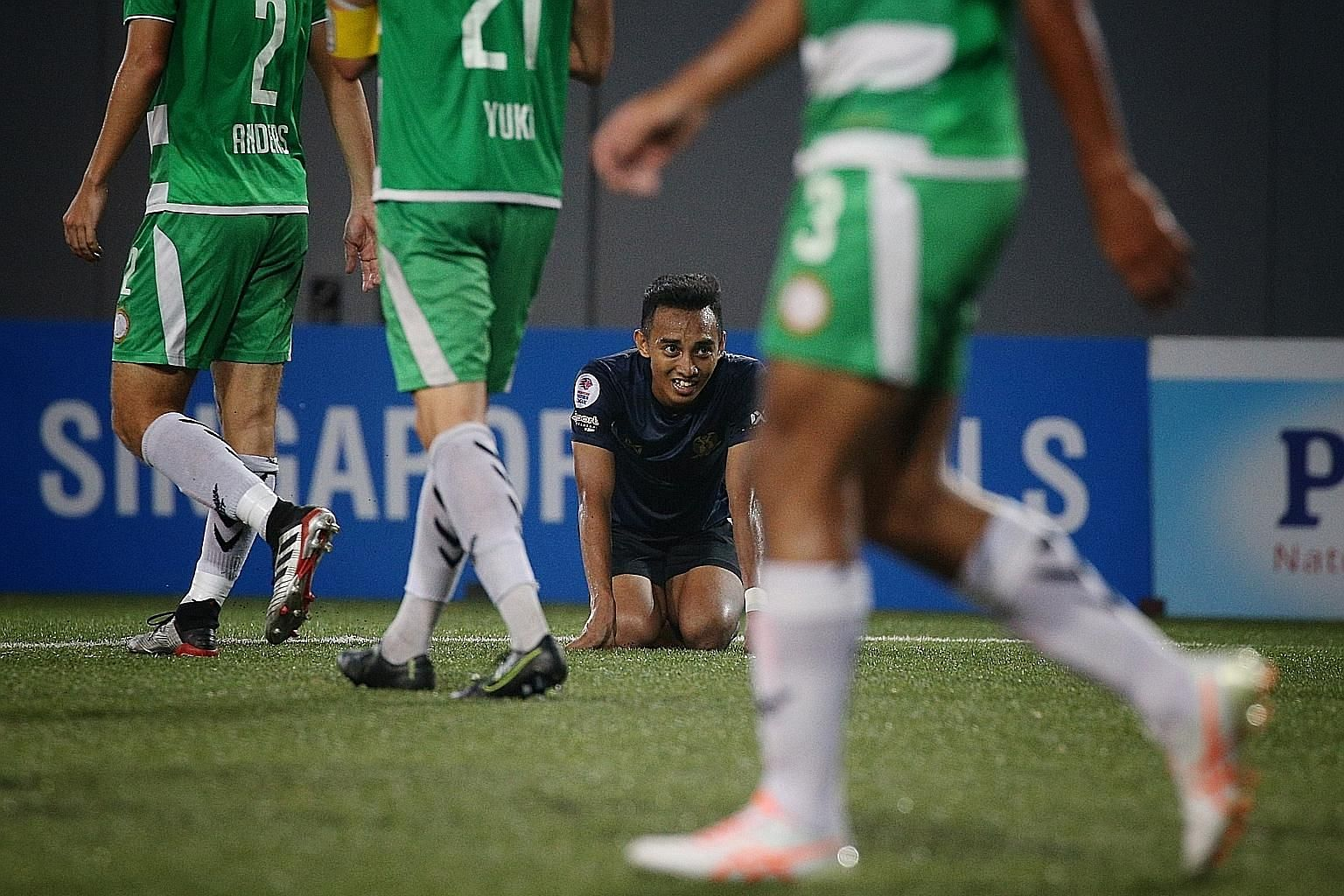 Hougang United's Faris Ramli showing his disappointment at a missed opportunity during his team's Singapore Premier League match against Geylang International at Our Tampines Hub yesterday. The game ended in a 4-4 draw.