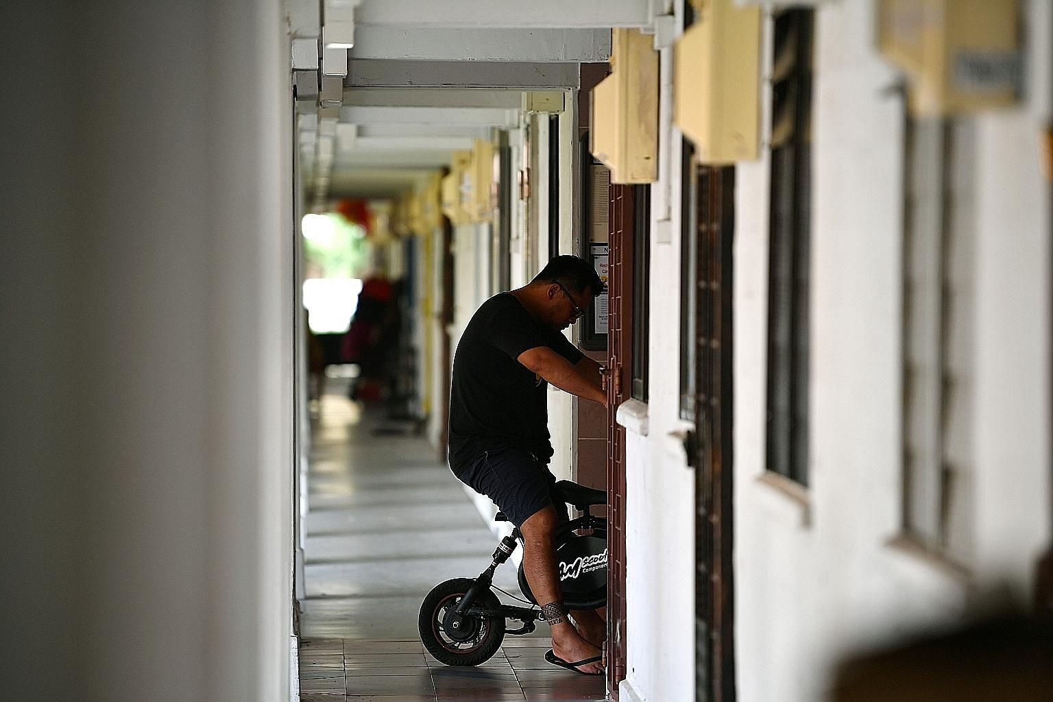 The rule banning the use of personal mobility devices, bicycles and power-assisted bicycles covers HDB common areas such as void decks, playgrounds, common corridors and play courts in estates. The town councils had said earlier that there will be a