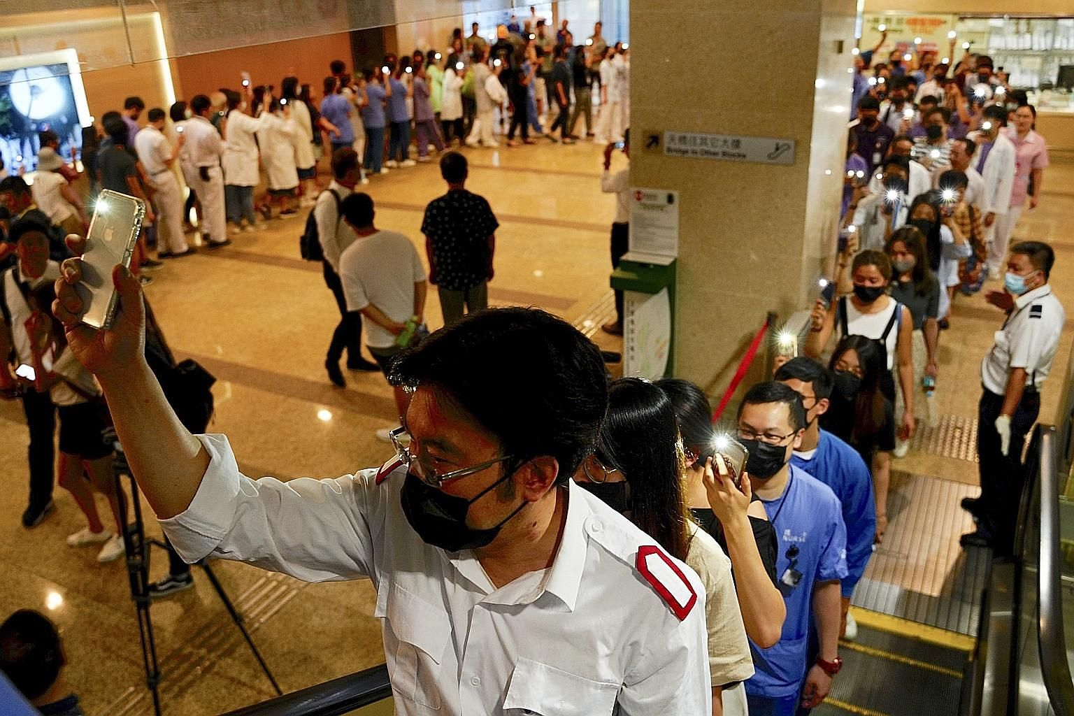 Medical workers protesting in the foyer of Prince of Wales Hospital in Hong Kong yesterday as the stand-off with the city's government continued. PHOTO: ASSOCIATED PRESS