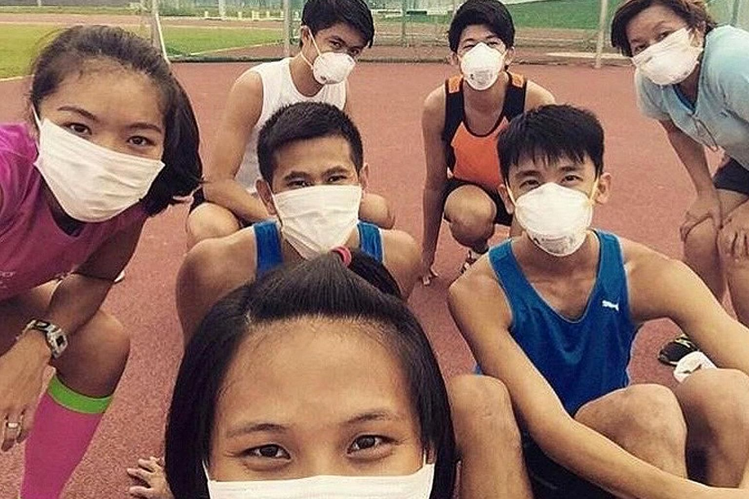 High jumper Michelle Sng (left) and her friends donned masks during their training sessions in 2015 when the haze situation was bad. PHOTO COURTESY OF MICHELLE SNG