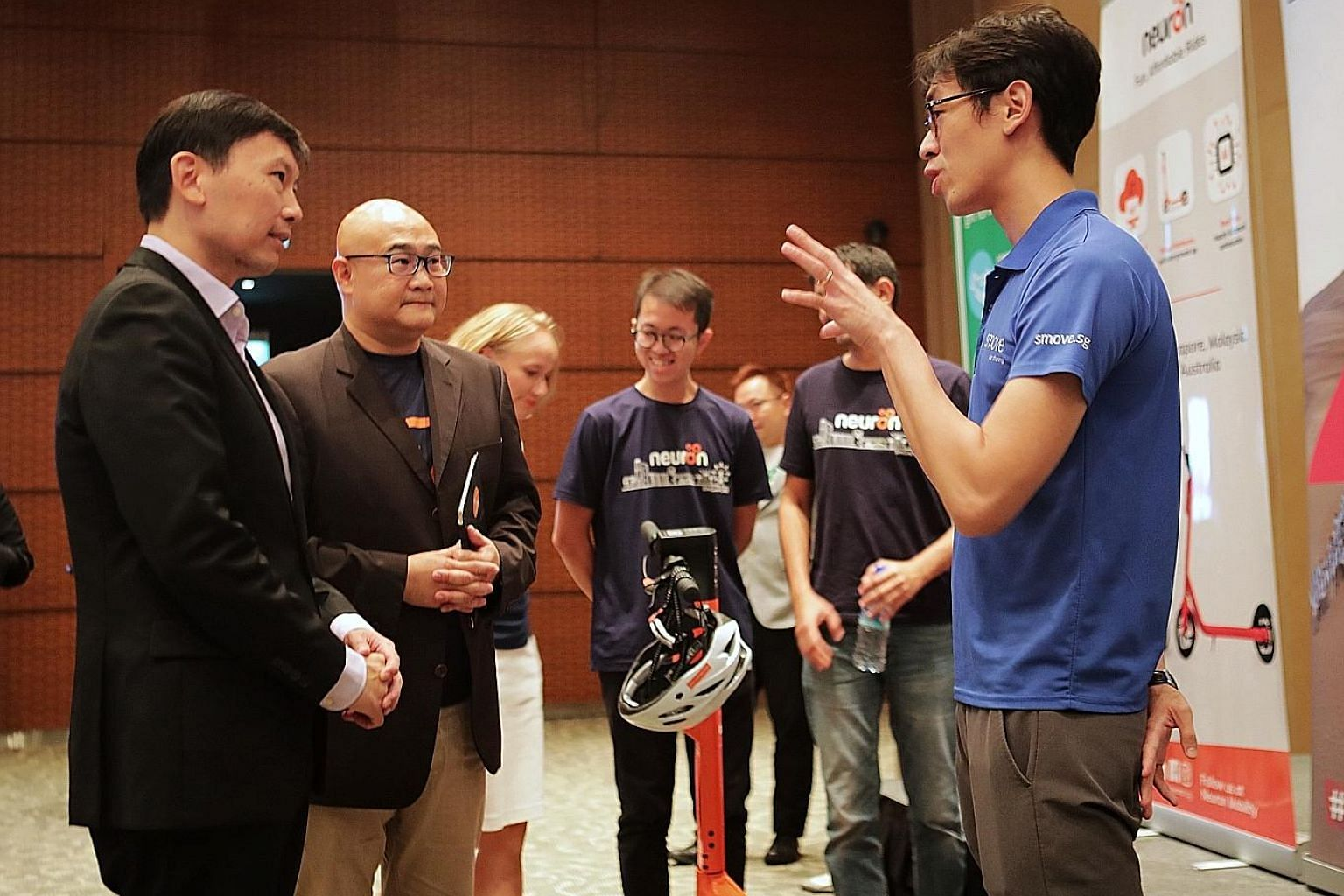 (From left) Senior Minister of State Chee Hong Tat and Mr Colin Lim, chief executive of mobilityX, speaking with Mr Joseph Ting, co-founder of car-sharing service Smove, at the official launch of Zipster at The Star Performing Arts Centre yesterday.