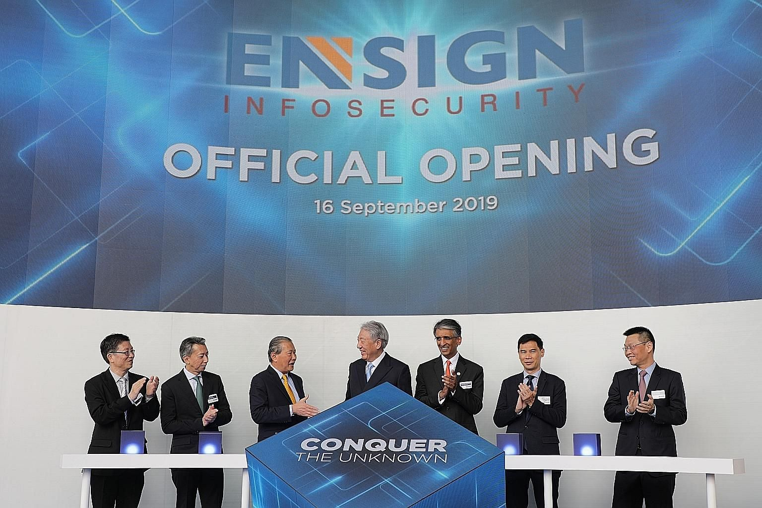 Senior Minister and Coordinating Minister for National Security Teo Chee Hean (centre) at the opening of Ensign InfoSecurity's global headquarters here yesterday with (from far left) Mr Teo Chin Hock, deputy chief executive of the Cyber Security Agen