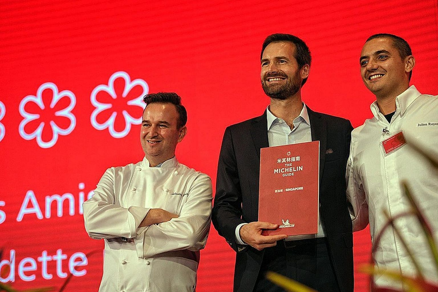 Chef Emmanuel Stroobant of Saint Pierre (far right) and chef Tristin Farmer of Zen, whose restaurants received two Michelin stars. Chef Sebastien Lepinoy (left) of Les Amis and chef-owner Julien Royer (right) of Odette with Mr Gwendal Poullennec, the