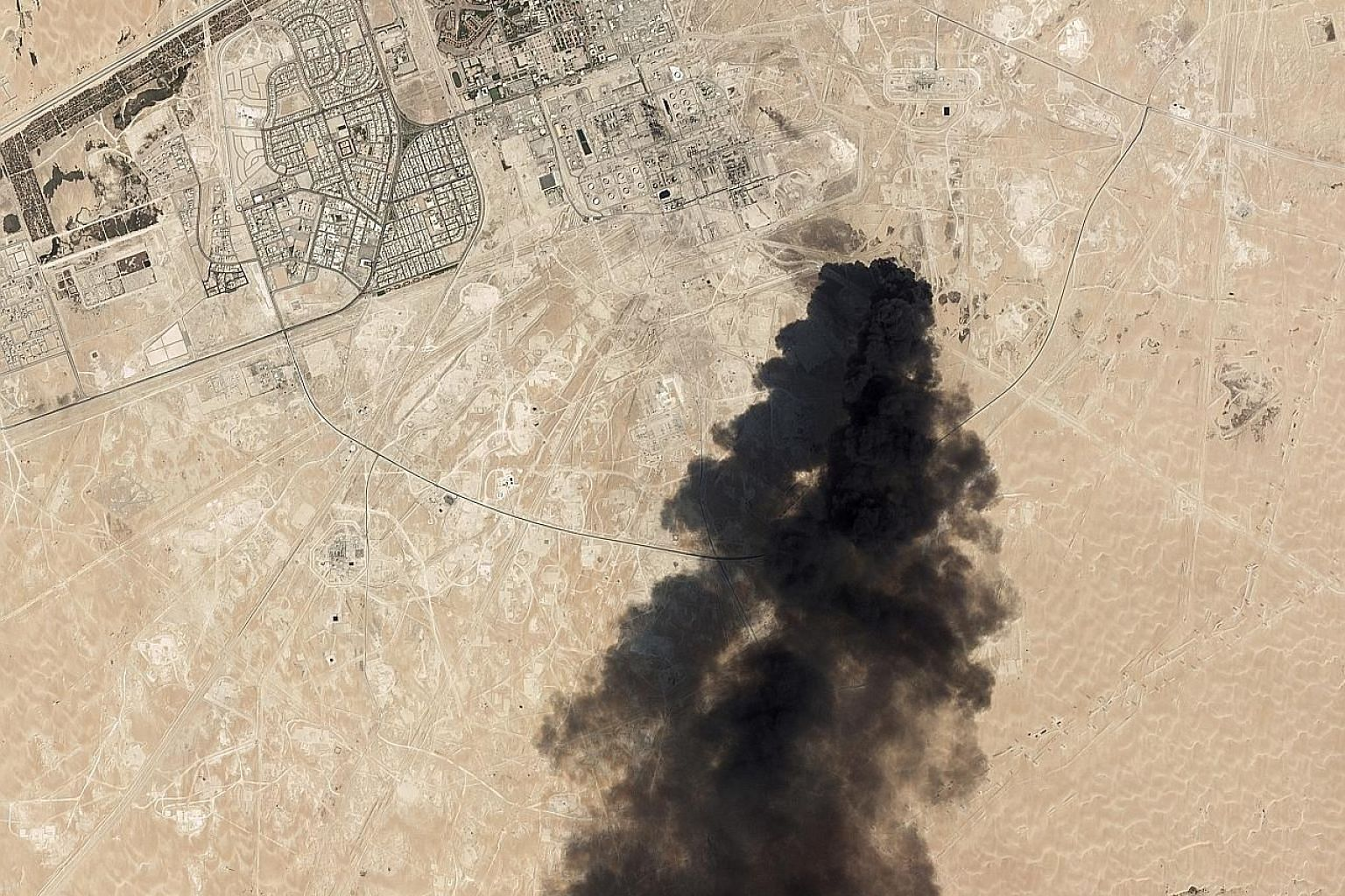 A satellite image from Planet Labs showing thick black smoke rising from Aramco's Abqaiq oil processing facility in Saudi Arabia last Saturday. The Houthis have claimed responsibility, Iran is being blamed and there are also suspicions that Iraqi par