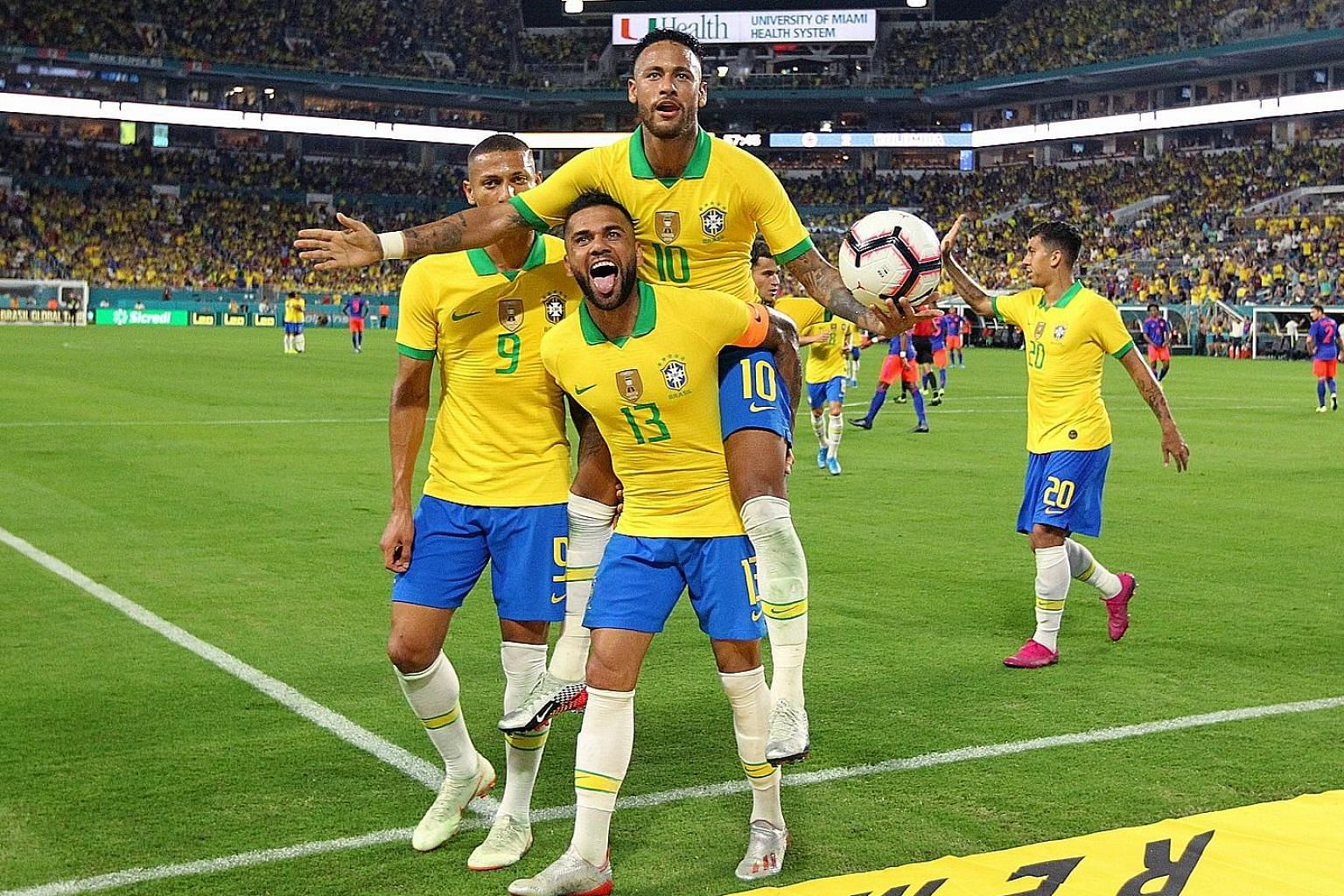 Brazil's Neymar (No. 10) celebrating with Dani Alves and teammates after scoring his side's second goal during the 2-2 friendly draw with Colombia at the Hard Rock Stadium, Florida, earlier this month. The flamboyant forward scored all four goals in