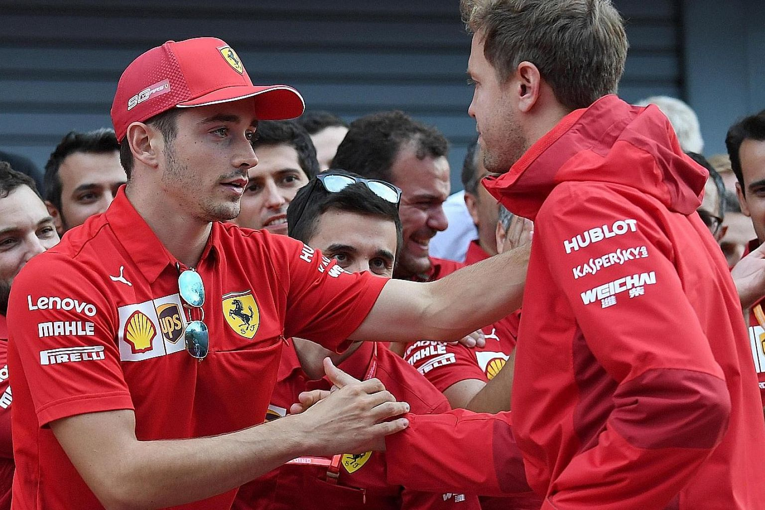 Ferrari's Charles Leclerc (left), on 182 points, has moved ahead of his teammate Sebastian Vettel (169) in the Formula One drivers' standings.