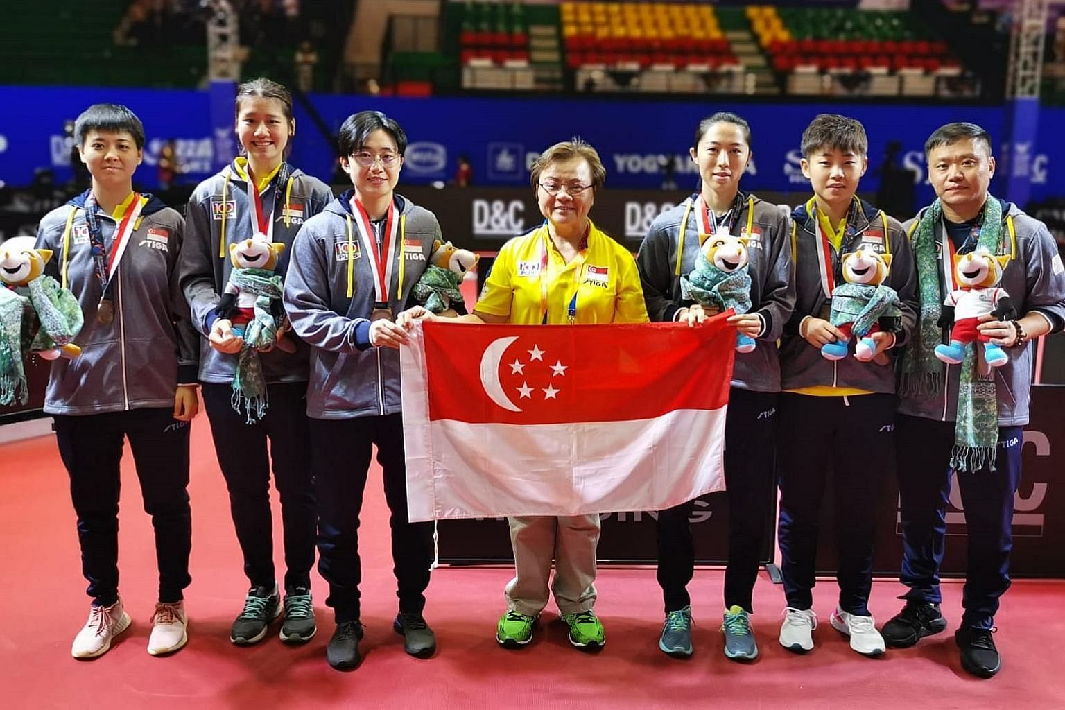 Singapore Table Tennis Association president Ellen Lee (centre) with the players and coach Hao Anlin (right) at the Asian championships. PHOTO: STTA