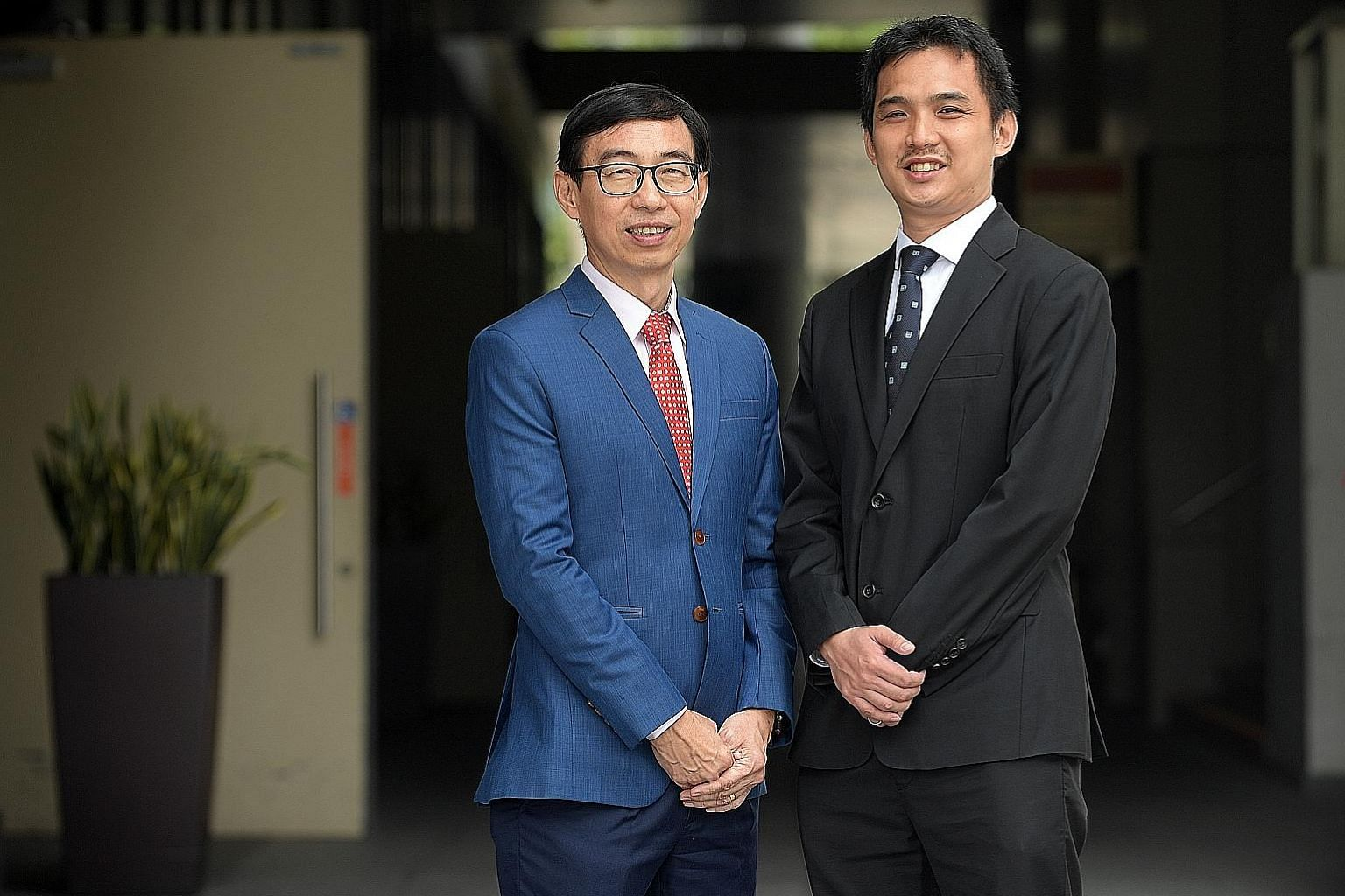 Mr Lim Hock Heng (far left), vice-president and site director at GSK's Pharmaceuticals Supply Chain Singapore, with GSK senior chemical engineer Charles Wong. Mr Wong had attended a Project Zodiac course, a key leadership training programme under the