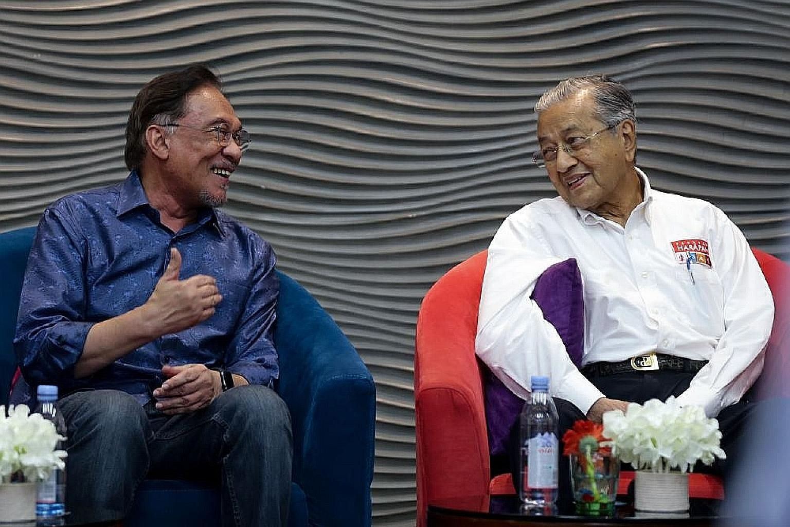 """A July 19 photo of Parti Keadilan Rakyat leader Anwar Ibrahim (left) with Prime Minister Mahathir Mohamad at the party's retreat in Port Dickson. Datuk Seri Anwar told Bloomberg there was an understanding he should take power around next May, """"but I"""