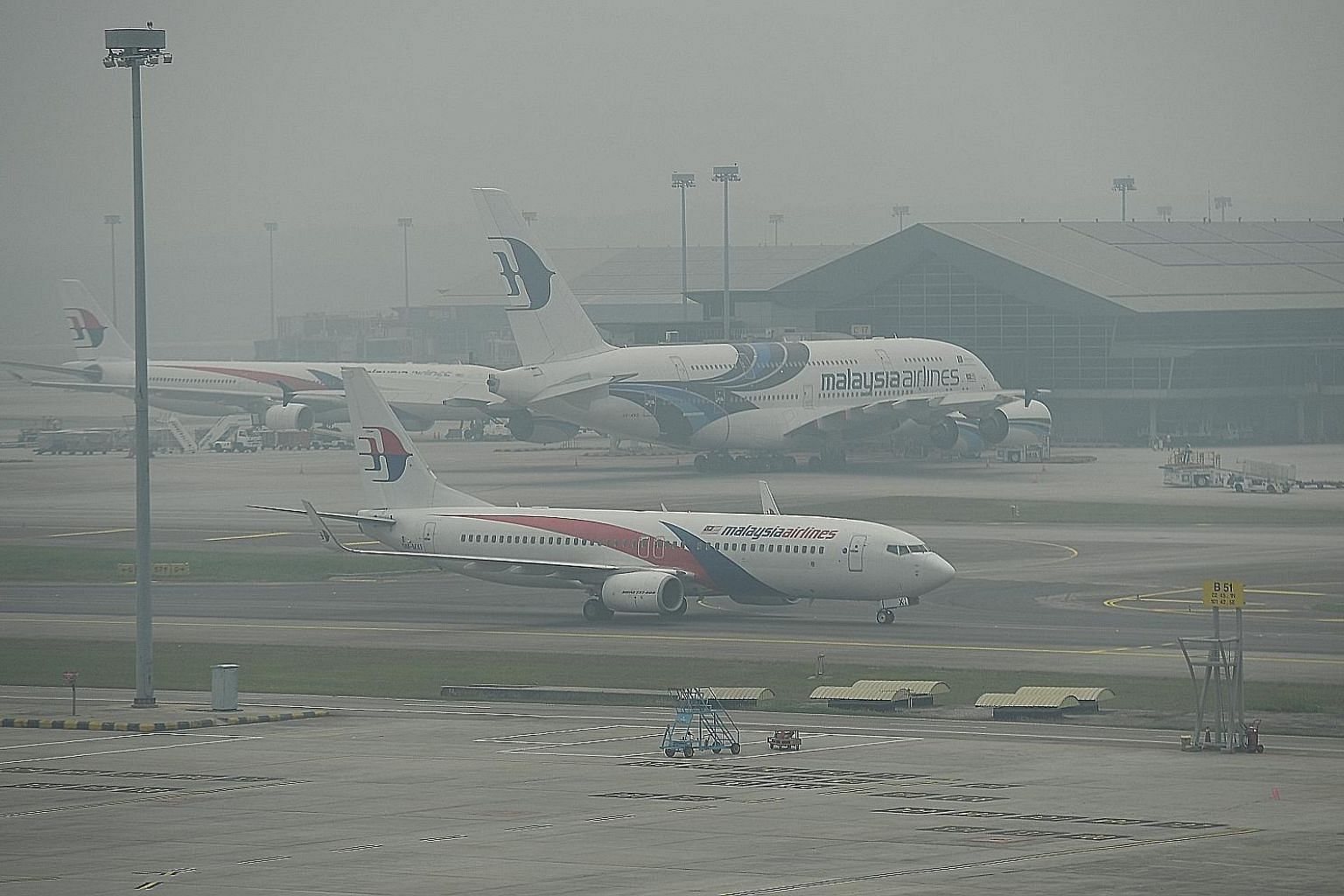 """Hazy conditions at Kuala Lumpur International Airport around noon yesterday. Air quality deteriorated to """"very unhealthy"""" levels yesterday on an official index in many parts of Peninsular Malaysia, forcing school closures."""