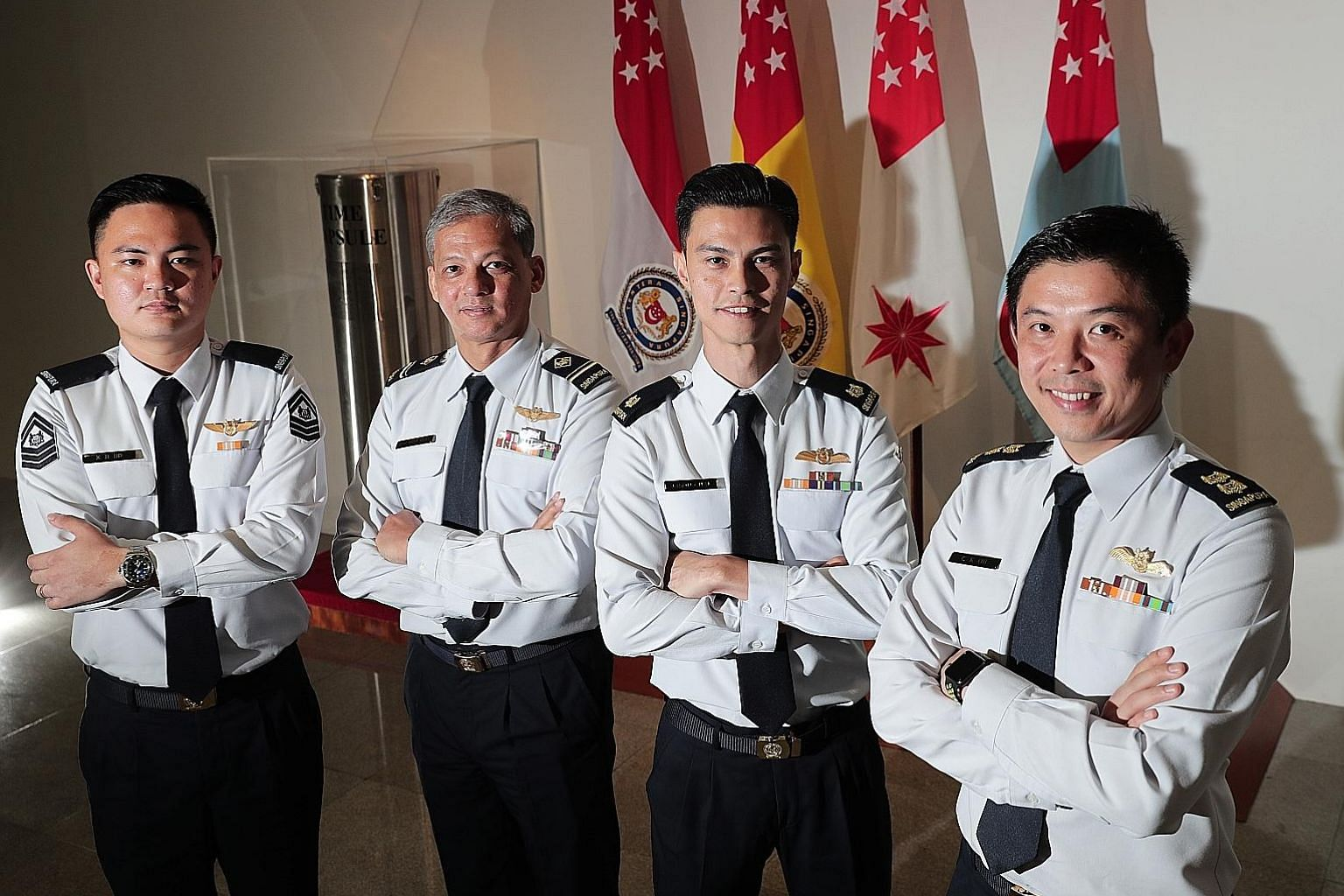 (From left) Staff Sergeant Keith Ho, Military Expert 4 Brian Rezel, Major Jason Chai and Lieutenant-Colonel Oh Chun Keong were among 95 military personnel who received Overseas Service Medals from Defence Minister Ng Eng Hen yesterday. Dr Ng said the
