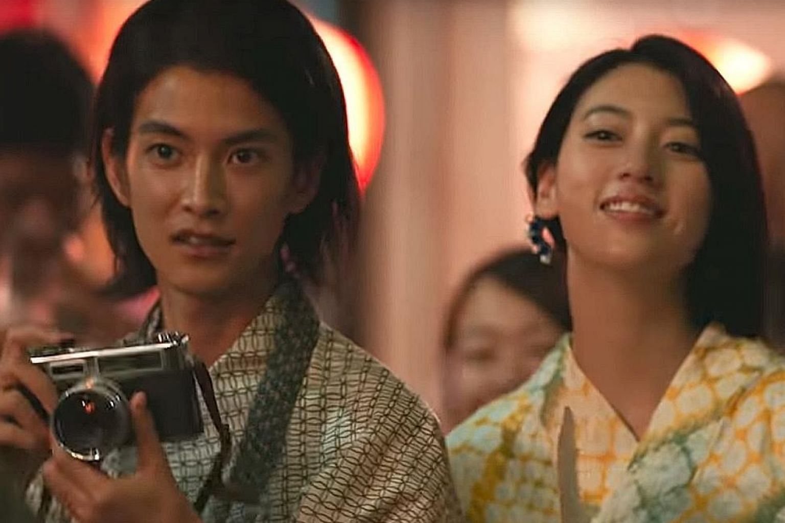 Jay Chou's new video has Japanese actress Ayaka Miyoshi (left) playing a woman who toils to support her boyfriend's photography dream.