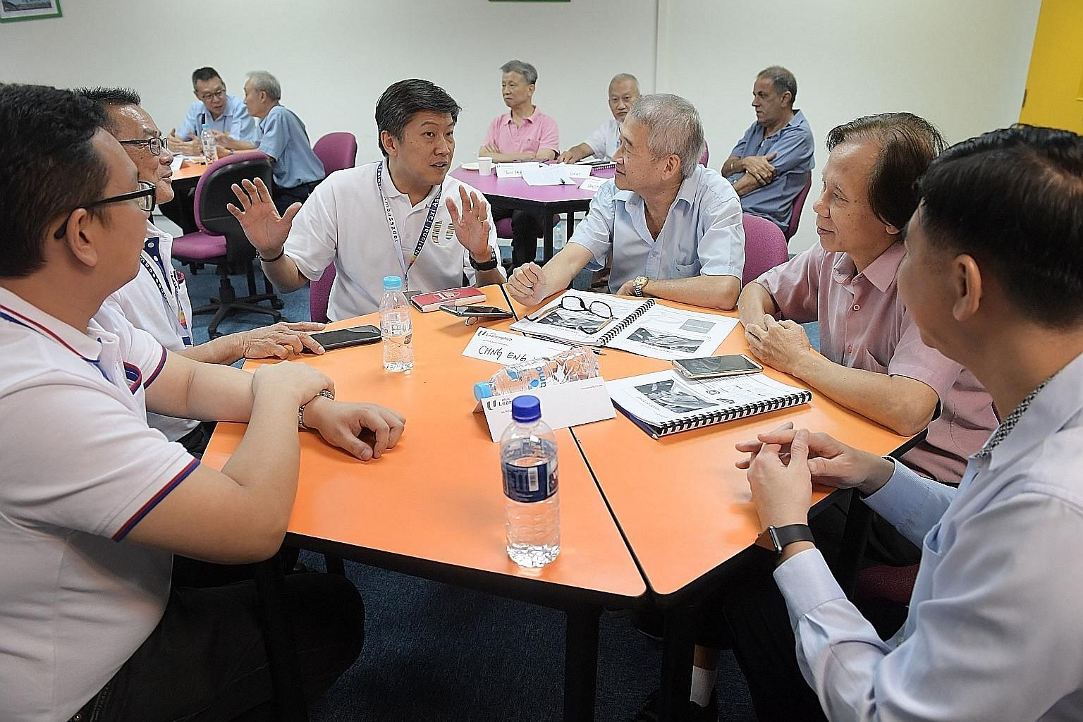 Labour chief Ng Chee Meng (centre) chatting with participants in a digital training class at the CityCab Building yesterday. The customised SkillsFuture for Digital Workplace one-day training programme started about three months ago, and a total of 1