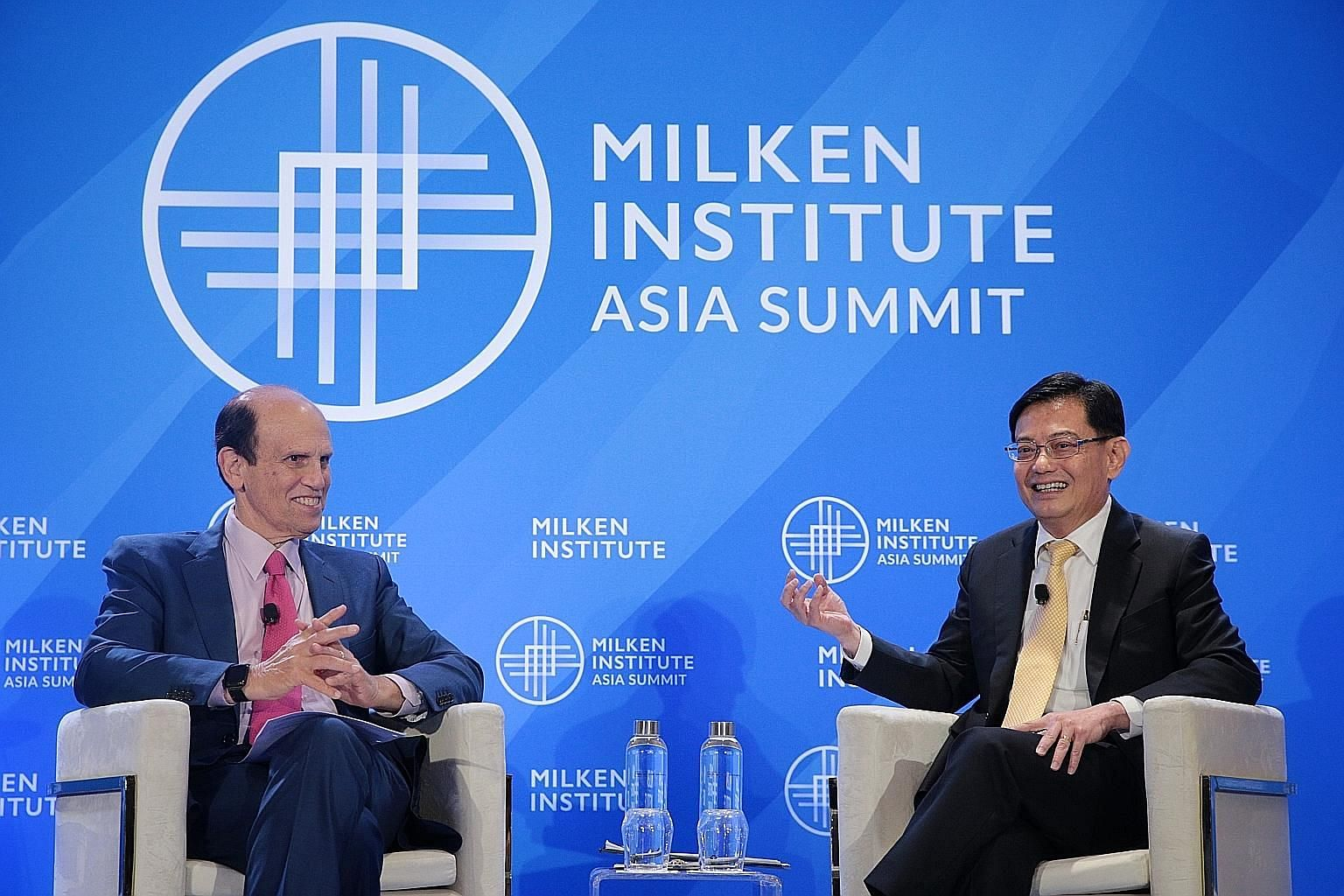 "Deputy Prime Minister Heng Swee Keat at a dialogue at the Milken Institute Asia Summit which was moderated by the institute's chairman Michael Milken yesterday. Mr Heng said the Government is ready to do ""what needs to be done at the right time"" to s"