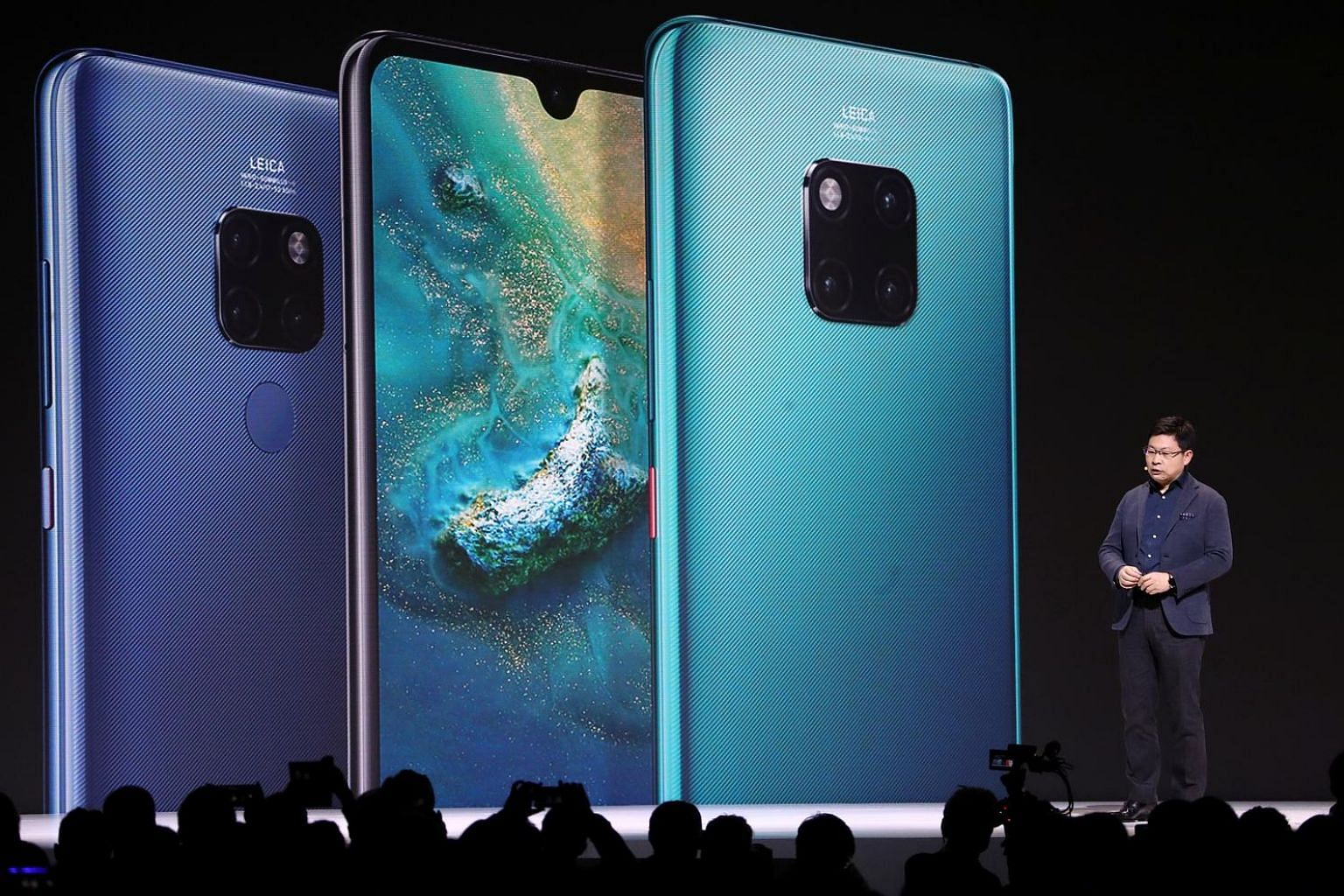 Huawei consumer business group chief executive Richard Yu presenting the Mate 30 models, among other new products, in Munich yesterday. He did not address the issue of Google compatibility, opting instead to focus on the phone's hardware features. PH