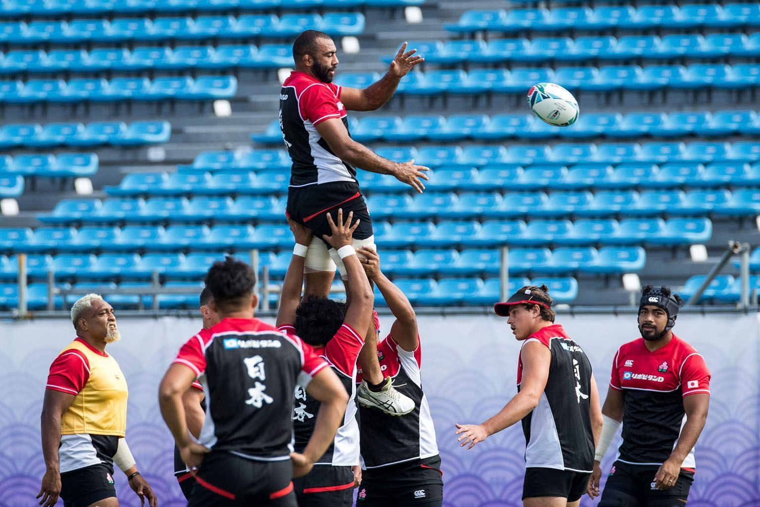 Japan flanker and captain Michael Leitch (top) training with his teammates at the Prince Chichibu Memorial Rugby Stadium in Tokyo ahead of the World Cup which begins today. PHOTO: AGENCE FRANCE-PRESSE