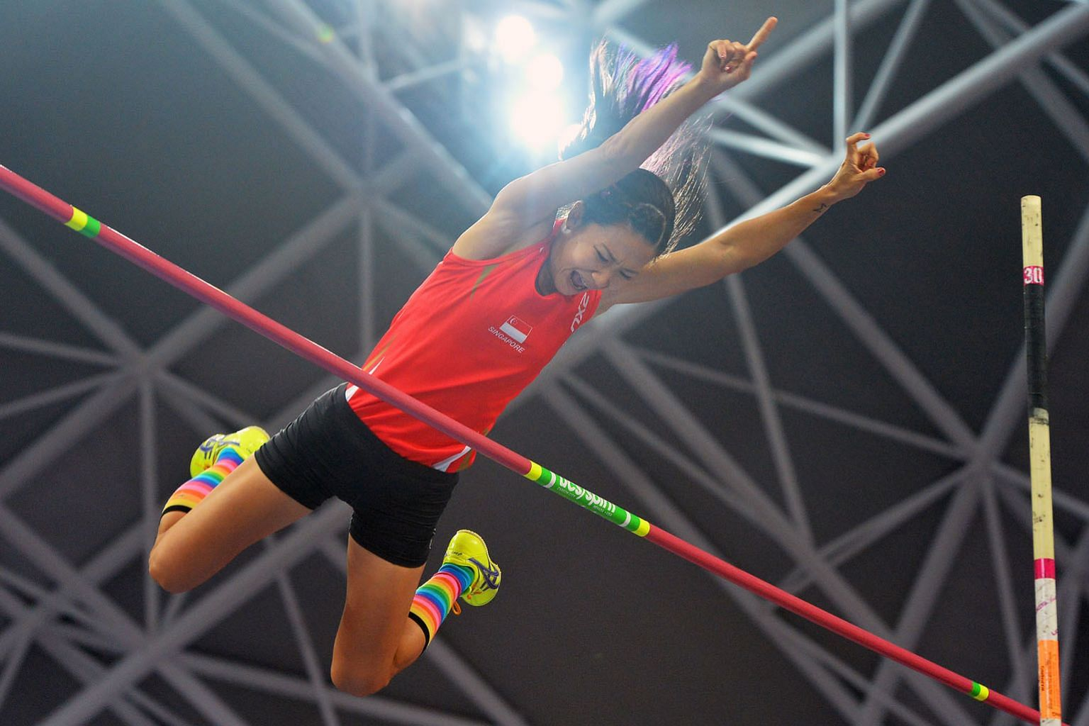 Rachel Yang clearing 3.90m to win the pole vault silver at the 2015 SEA Games in Singapore. She holds the national record of 3.91m and also won a bronze at the 2017 SEA Games in Kuala Lumpur. ST FILE PHOTO