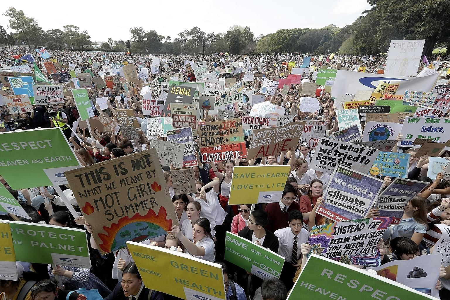 THAILAND: Activists playing dead as part of a demonstration near the Ministry of Natural Resources and Environment's office in Bangkok. JAPAN: Participants marching at an event to mark the day of global climate strikes in Tokyo. AUSTRALIA: Thousands