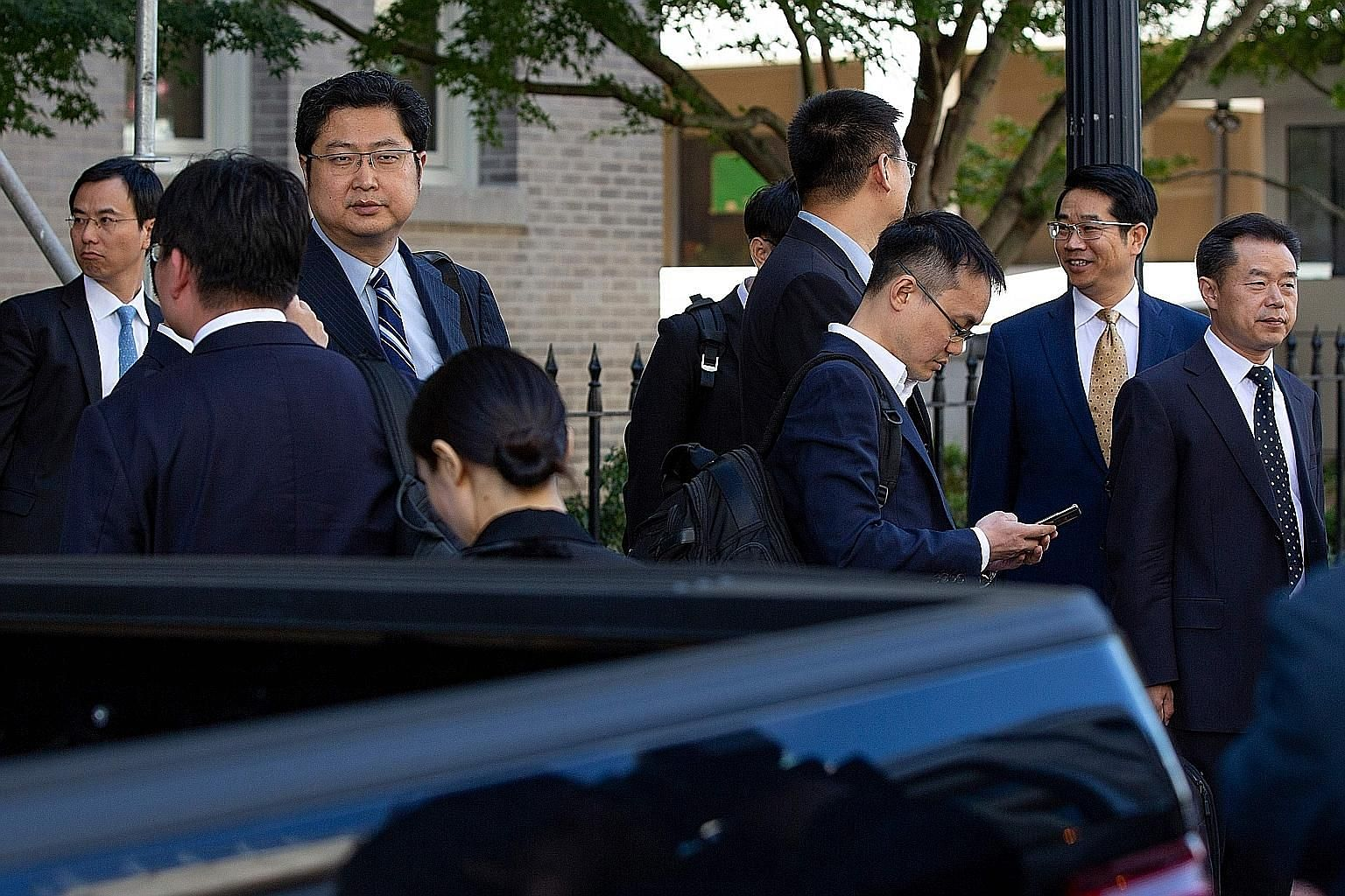 Members of the Chinese delegation waiting to leave after deputy-level trade talks in Washington on Thursday. The talks are expected to lay the groundwork for top-level negotiations next month.