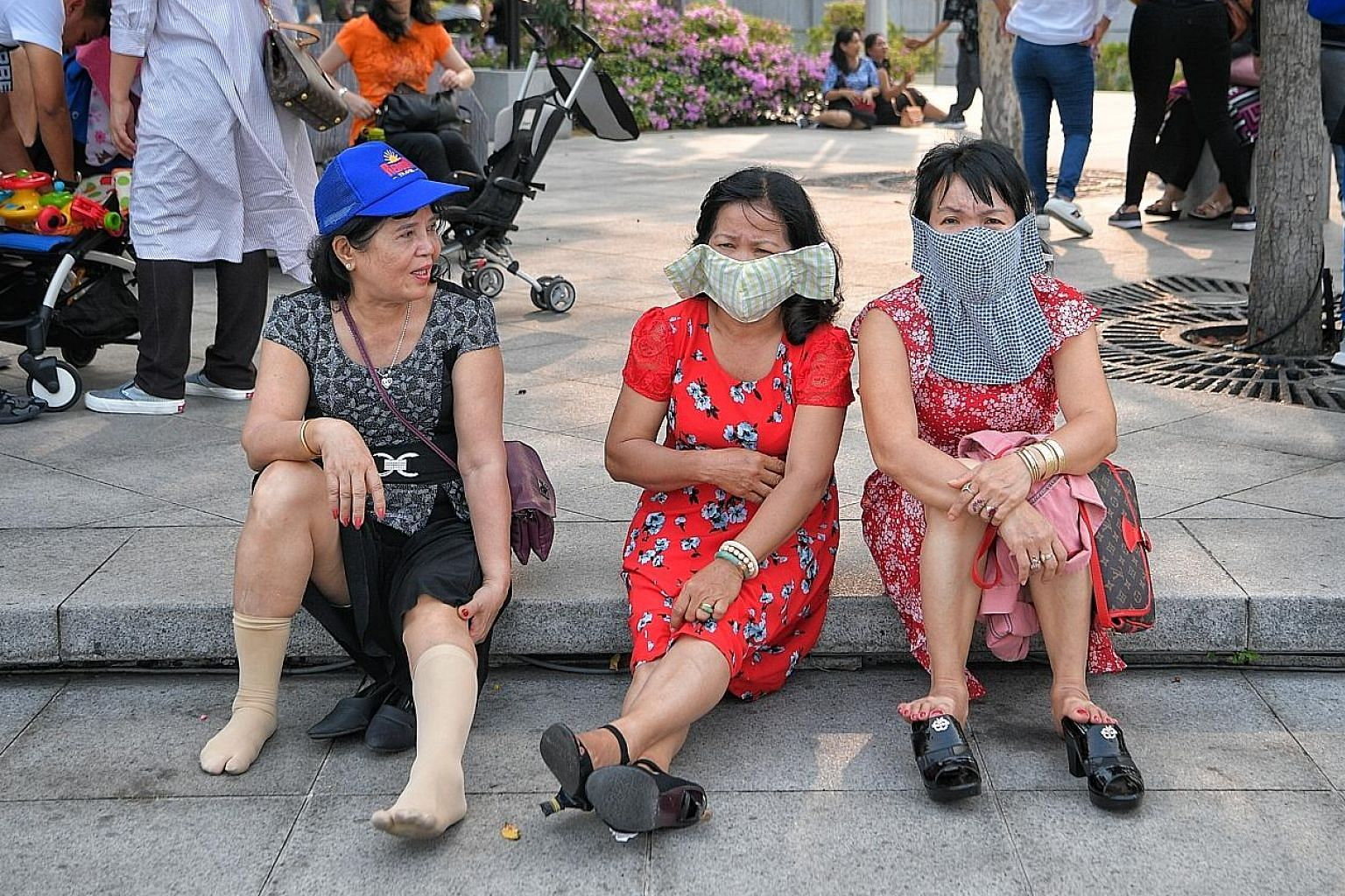 Vietnamese tourists wearing masks in Singapore last week.