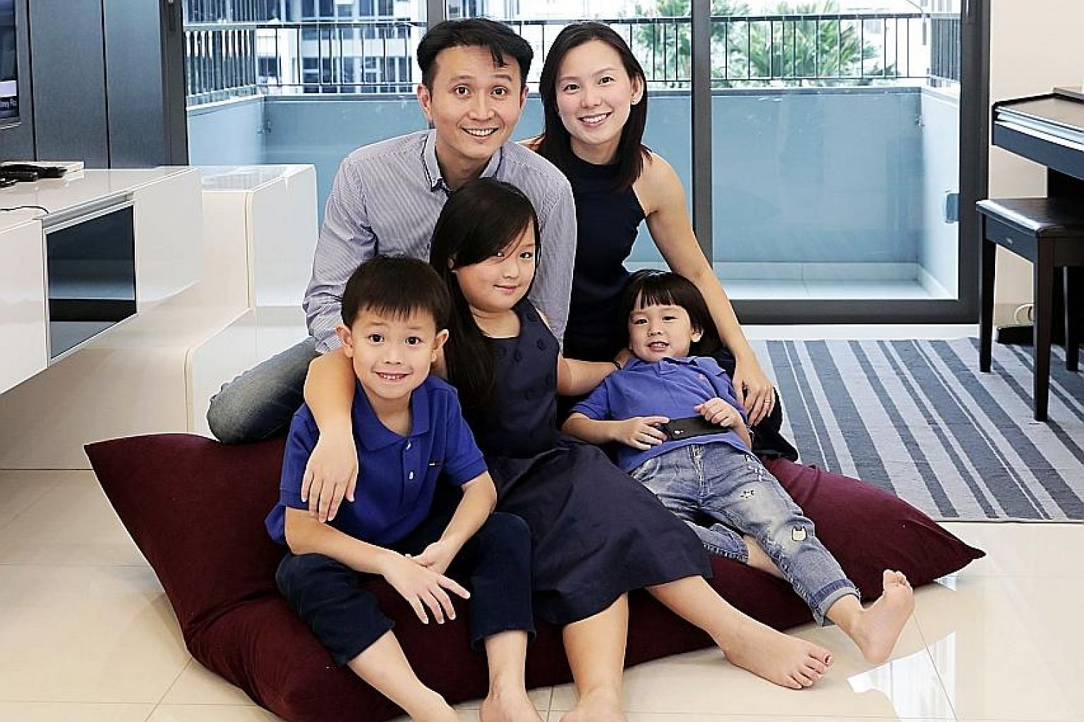 Mr Ryner Koh with his wife Diana Chang and their sons Zace (left) and Leadence as well as daughter Arissa in their executive condominium unit at Prive in Punggol Field. ST PHOTO: KELVIN CHNG