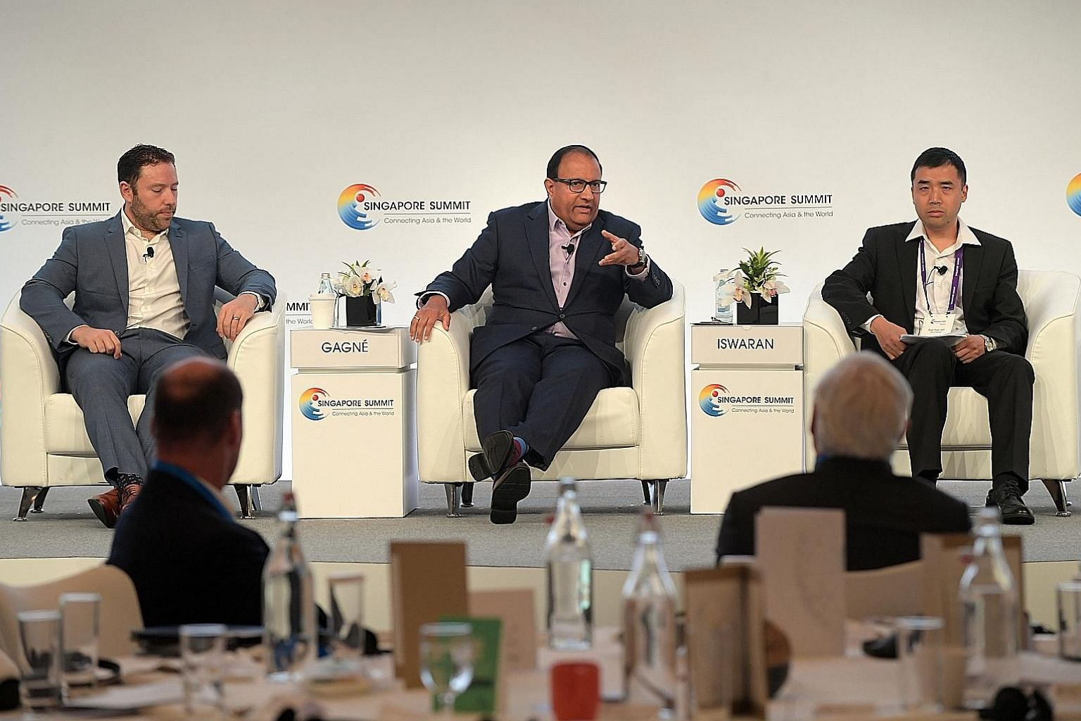 Mr S. Iswaran, Minister for Communications and Information, at the panel discussion of the annual Singapore Summit with Mr Jean-Francois Gagne (left), chief executive of software firm Element AI, and Professor Xue Jun (right) of Peking University Law