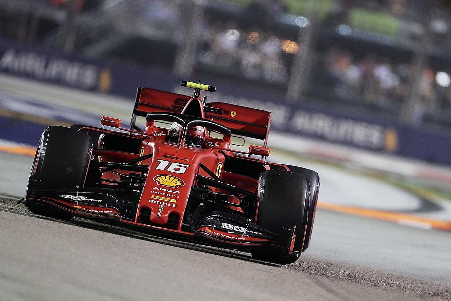 Ferrari driver Charles Leclerc of Monaco rounding Turn 3 during last night's qualifying for the Singapore Airlines Singapore Grand Prix. He set the best time of 1:36.217 despite losing control three times during his flying lap. ST PHOTO: KELVIN CHNG