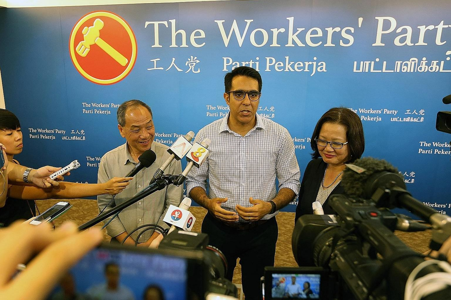A file picture taken in April last year after the Workers' Party former chief, Mr Low Thia Khiang (left), passed the baton to Aljunied GRC MP Pritam Singh (centre) to complete the phase of WP's leadership renewal. Mr Singh, who was elected unopposed