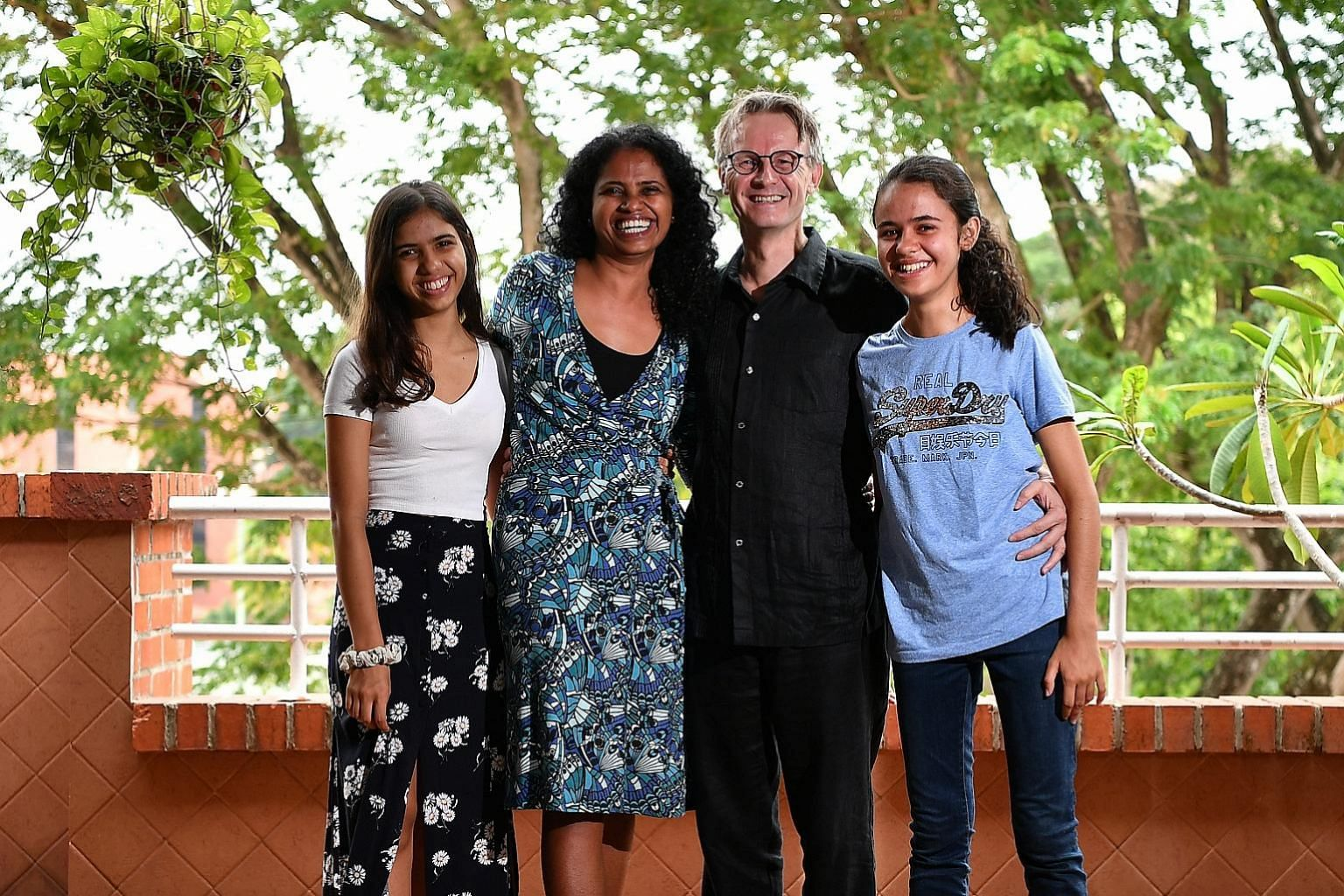 Ms Gloria Pereira, 46, with her husband Torben Kragh Joergensen, 55, and daughters Hannah (left), 17, and Christa, 20.