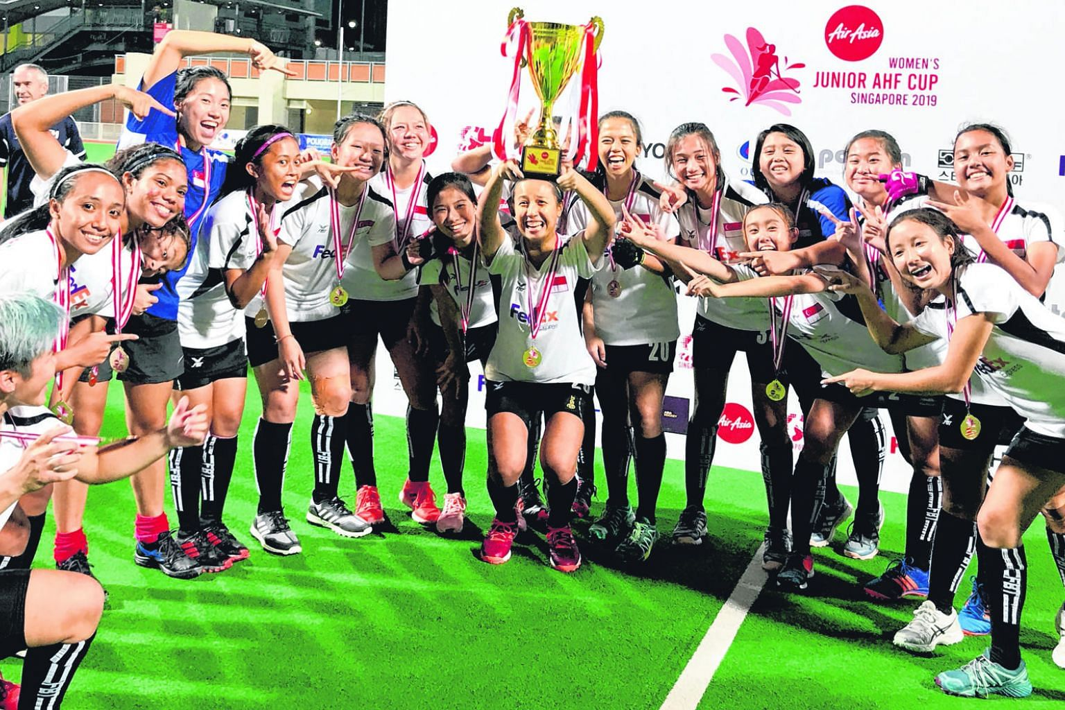 The victorious Singapore team, celebrating winning the Women's Junior AHF Cup at the Sengkang Hockey Stadium last week.