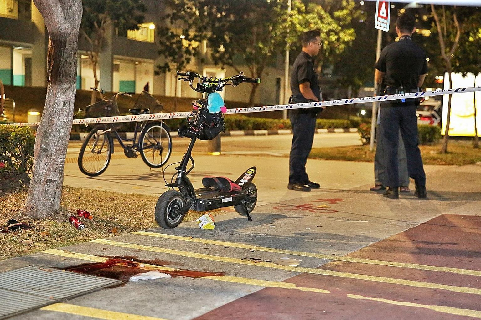 Photographs of the scene of the accident in Bedok North show bloodstains on the pavement next to the cycling path. PHOTO: SHIN MIN DAILY NEWS