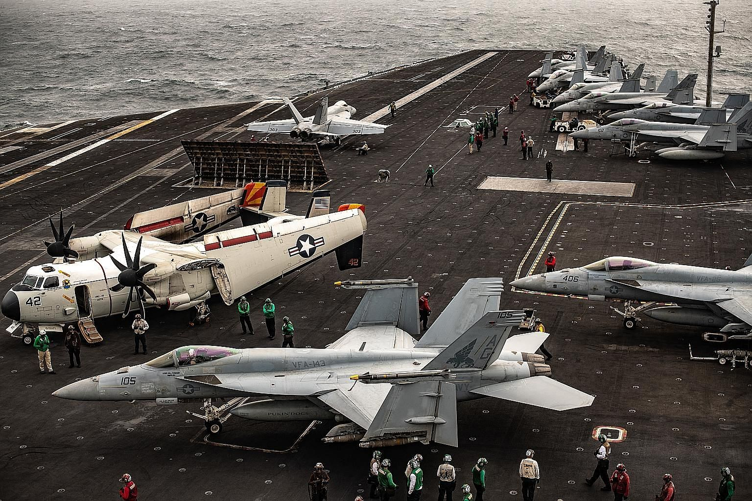 Aircraft on the flight deck of the USS Abraham Lincoln, in the North Arabian Sea. The ship was preparing to launch an attack against Iran on June 20, but the final order never came. PHOTO: NYTIMES
