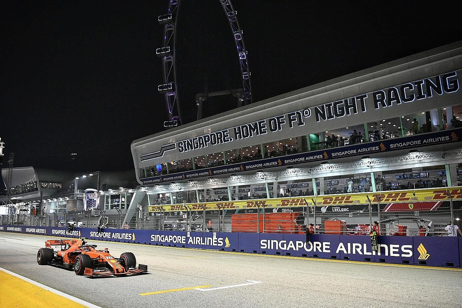 Charles Leclerc burning rubber on the Marina Bay Street Circuit during the 12th Singapore Grand Prix on Sunday. Singapore's current deal to host the night race runs till 2021. ST PHOTO: ARIFFIN JAMAR