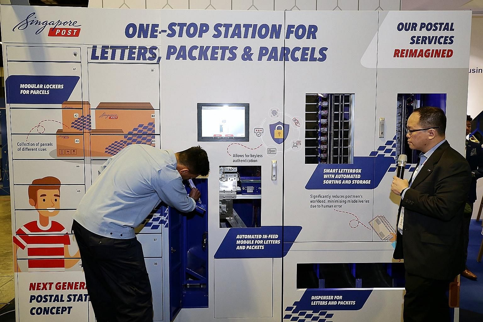 A postman putting mail into the central deposit of SingPost's smart letterbox prototype, with Mr Edmund Tan, SingPost's vice-president of innovation for postal services, explaining how the machine scans data matrix codes and then sorts mail into stor