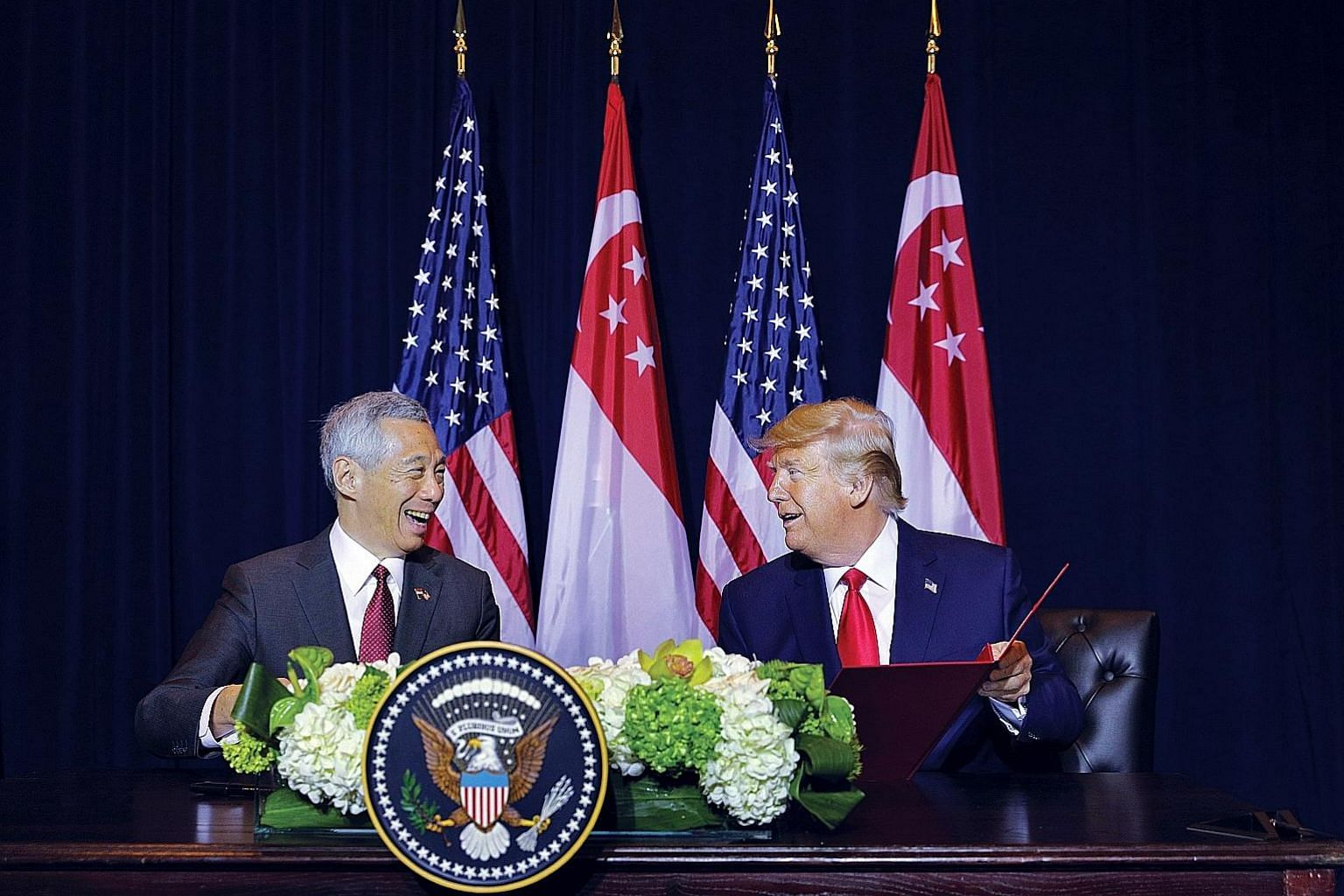 Prime Minister Lee Hsien Loong and US President Donald Trump signing an amendment to the 1990 defence agreement in New York on Monday. Both leaders lauded the close relationship between Singapore and the US. ST PHOTO: GAVIN FOO