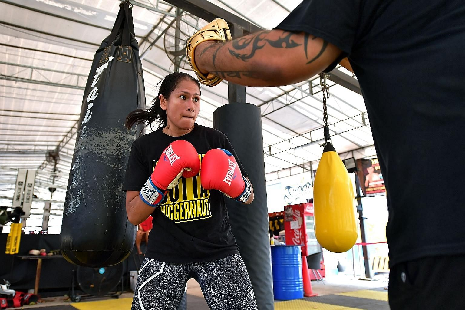 Local professional boxer Nurshahidah Roslie training for her WBC Silver bout on Saturday against China's Fan Yin. The sport is tough not only on her body but also burns a hole in her pocket - while she is a trailblazer for women boxers here, she has