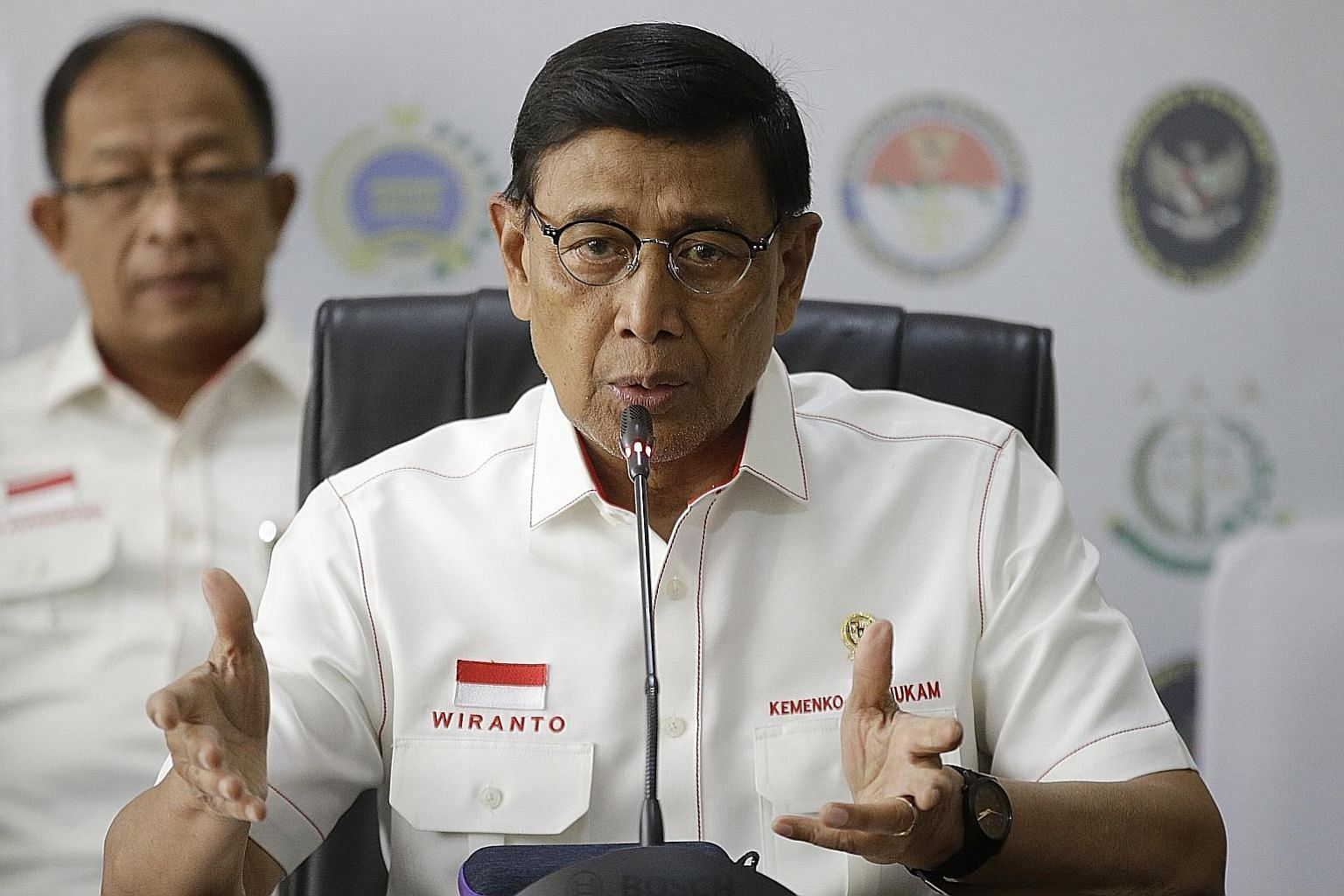 Coordinating Minister of Political, Legal and Security Affairs Wiranto met top officials yesterday to discuss the security situation. PHOTO: ASSOCIATED PRESS