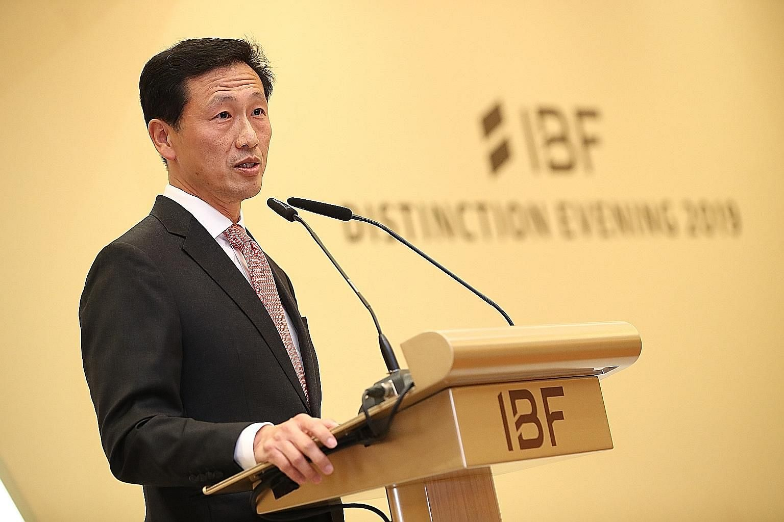 Above: OCBC Bank's consumer financial services head Dennis Tan was one of five recipients of the IBF Distinguished Fellow Award yesterday. Left: Education Minister Ong Ye Kung, speaking at the IBF's gala dinner yesterday, encouraged finance professio
