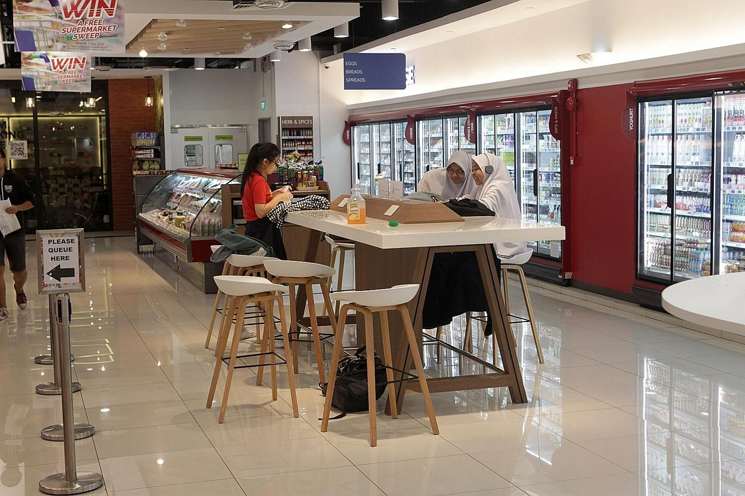 Students gathering at the Habitat by Honestbee supermarket in Pasir Panjang to study last Monday afternoon. A schoolgirl at her laptop in the Koufu food court at Sengkang General Hospital last Thursday. One of the unconventional study hot spots that