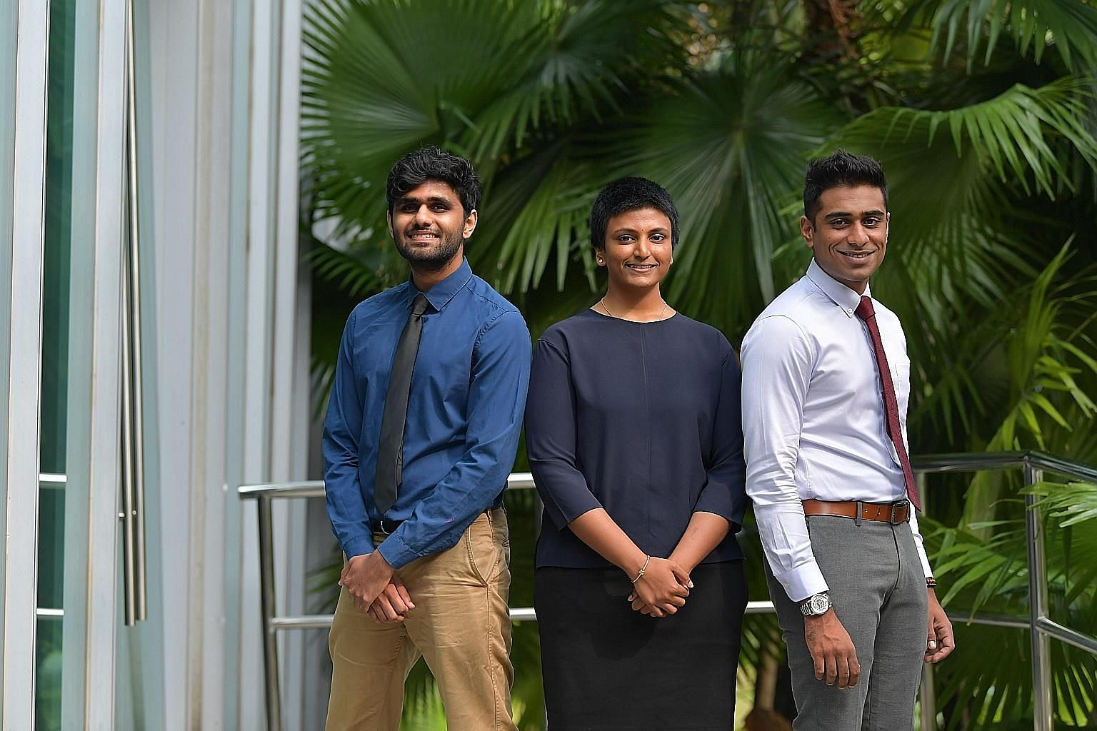Among those receiving Sinda's Excellence Award yesterday were (from left) Mr Suraendher Kumarr, 25, Ms Angelyn Puspa-Nathan, 21, and Mr Mohamed Nizar Bathushaa Mohamed Hanifah, 24. ST PHOTO: NG SOR LUAN