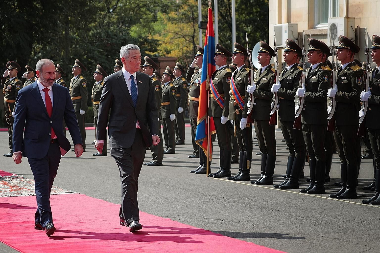 Prime Minister Lee Hsien Loong and his Armenian counterpart Nikol Pashinyan reviewing the guard of honour during a welcome ceremony at the Governmental Residence in the Armenian capital Yerevan yesterday. PM Lee said both Singapore and Armenia are sm