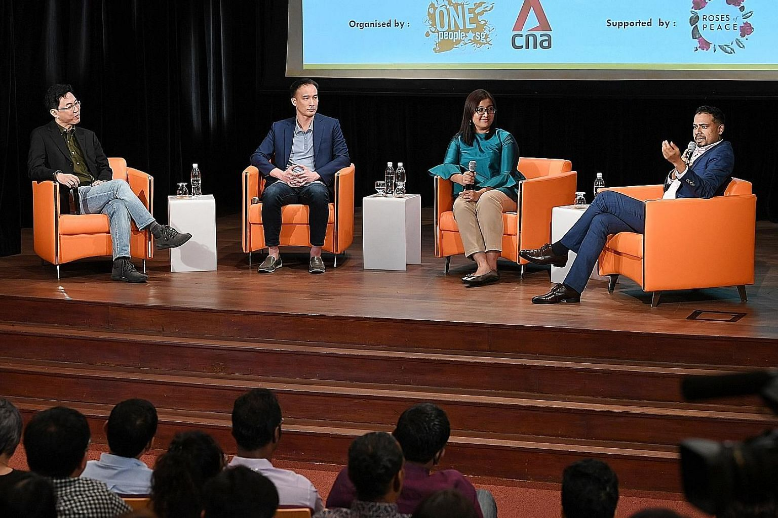 """Panel members (from left) Adrian Heng, Leonard Lim, Nadia Ahmad Samdin and David Reddy at the second session of """"Regardless of Race - The Dialogue"""" yesterday, where some of the 170 Singaporeans in attendance shared their views on issues such as navig"""