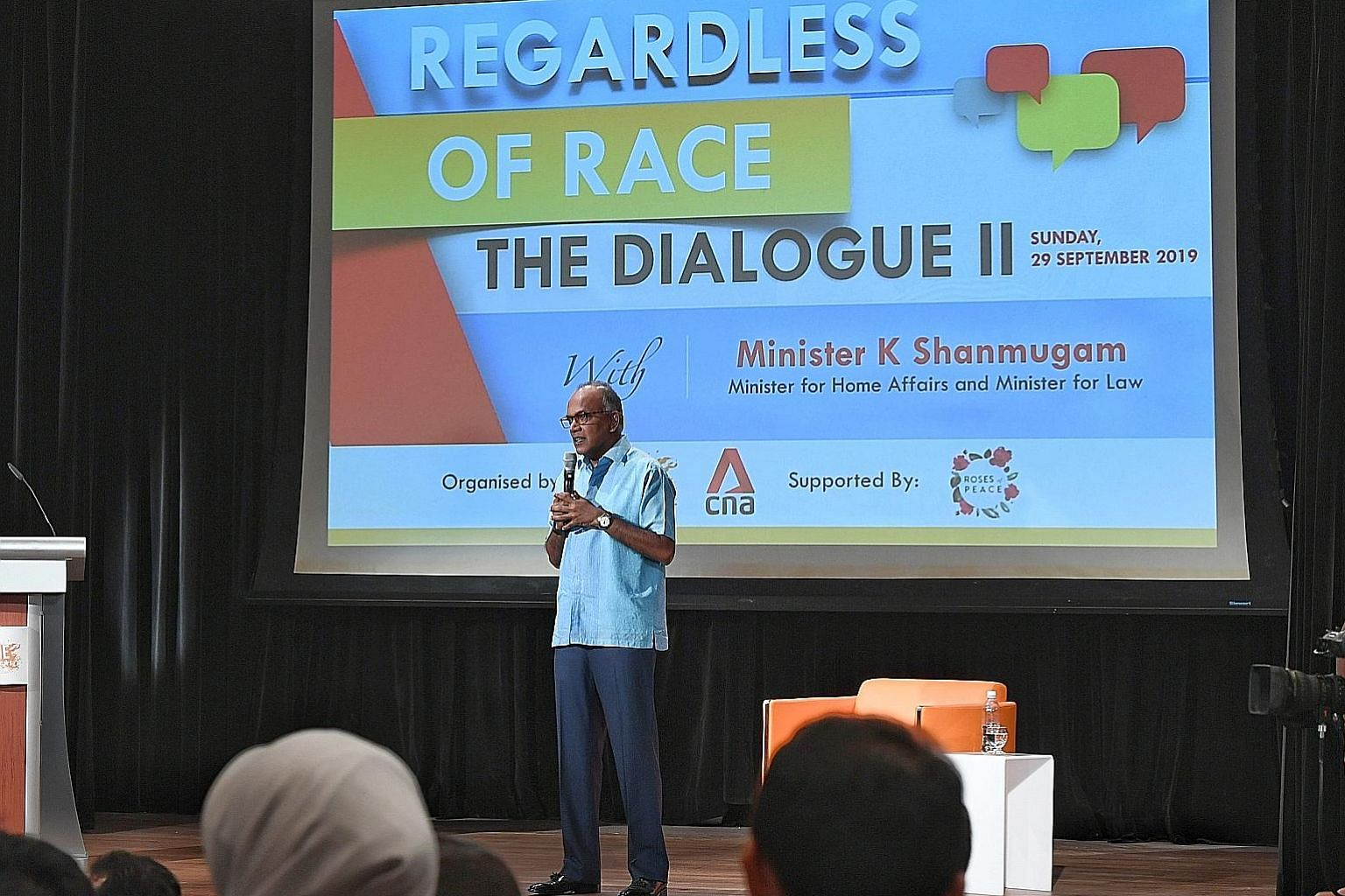 Home Affairs and Law Minister K. Shanmugam addressing the audience at yesterday's dialogue. He fielded questions on issues such as creating safe spaces for open discourse. ST PHOTO: KHALID BABA